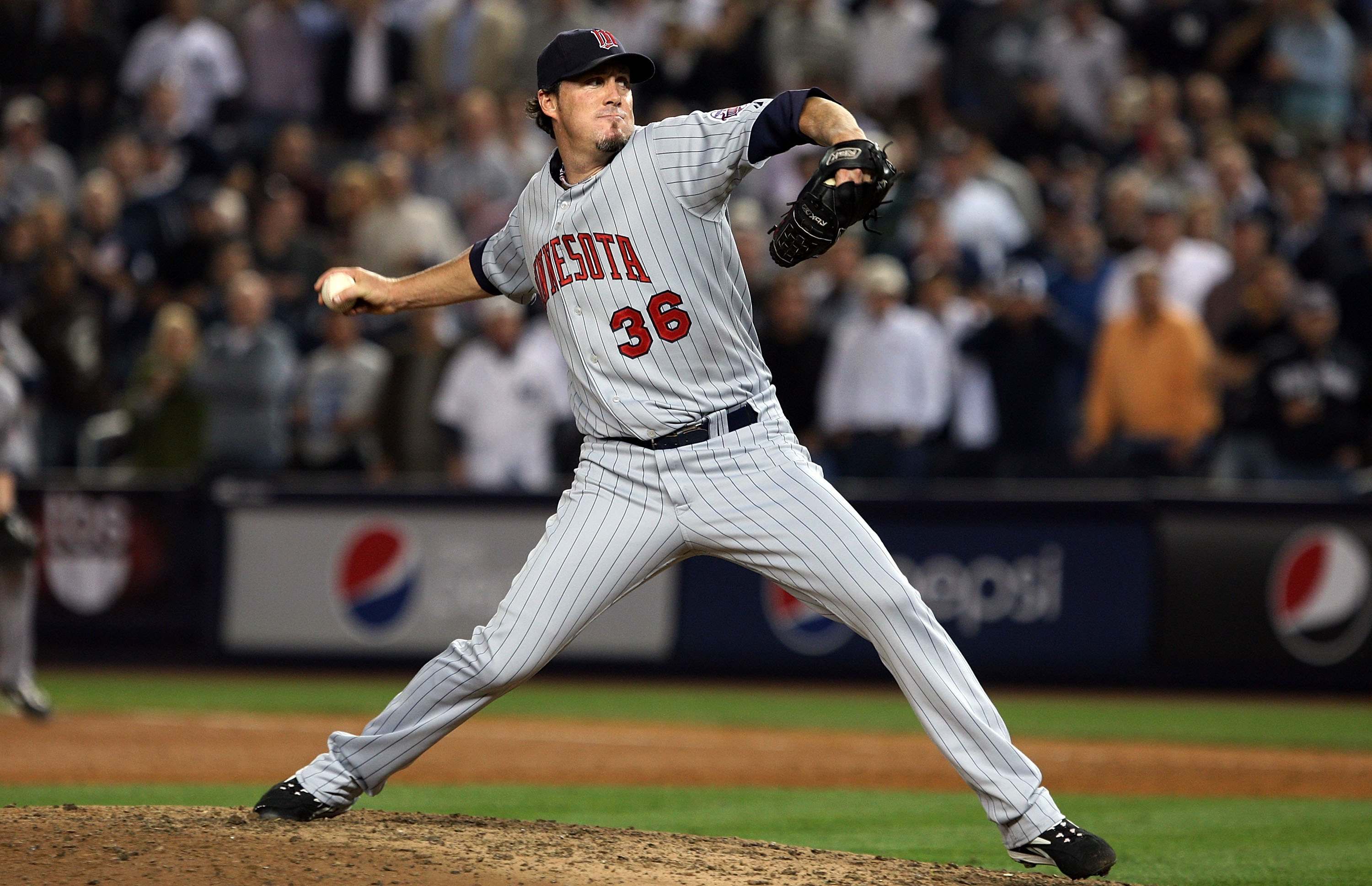 NEW YORK - OCTOBER 09: Joe Nathan #36 of the Minnesota Twins pitches against the New York Yankees in Game Two of the ALDS during the 2009 MLB Playoffs at Yankee Stadium on October 9, 2009 in the Bronx borough of New York City. (Photo by Jim McIsaac/Getty