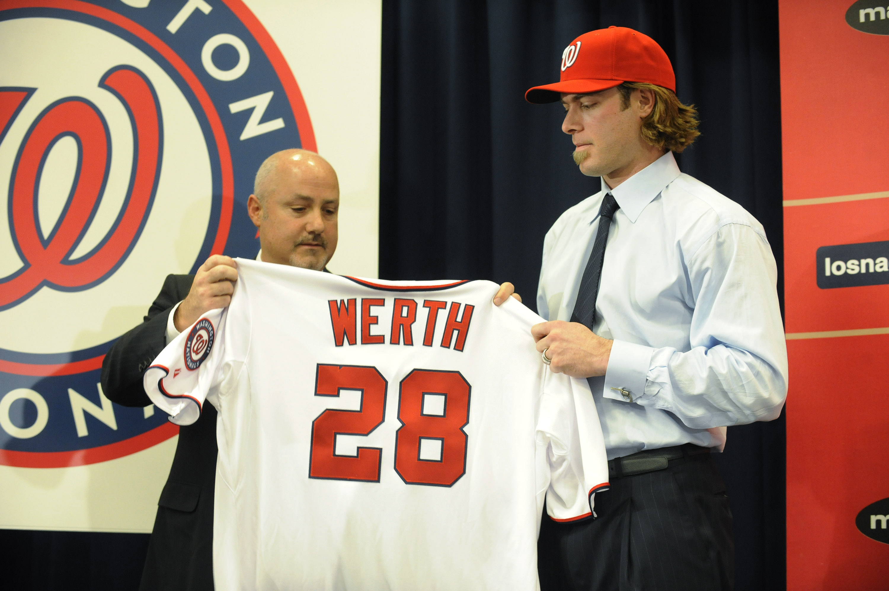 WASHINGTON, DC - DECEMBER 15:  Executive Vice President of Baseball Operations and General Manager Mike Rizzo (L) introduces Jayson Werth #28  to the media on December 15, 2010 at Nationals Park in Washington, DC.   (Photo by Mitchell Layton/Getty Images)