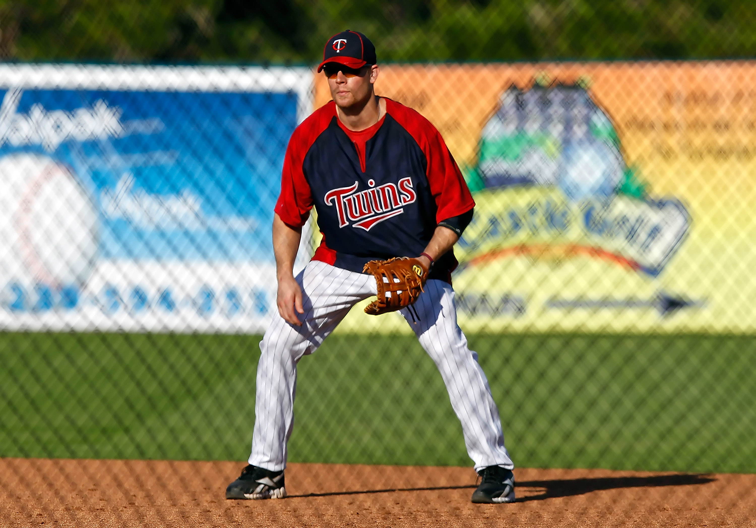 FORT MYERS, FL - FEBRUARY 27:  First baseman Justin Morneau #33 of the Minnesota Twins takes some ground balls just before the start of the Grapefruit League Spring Training Game against the Boston Red Sox at Hammond Stadium on February 27, 2011 in Fort M