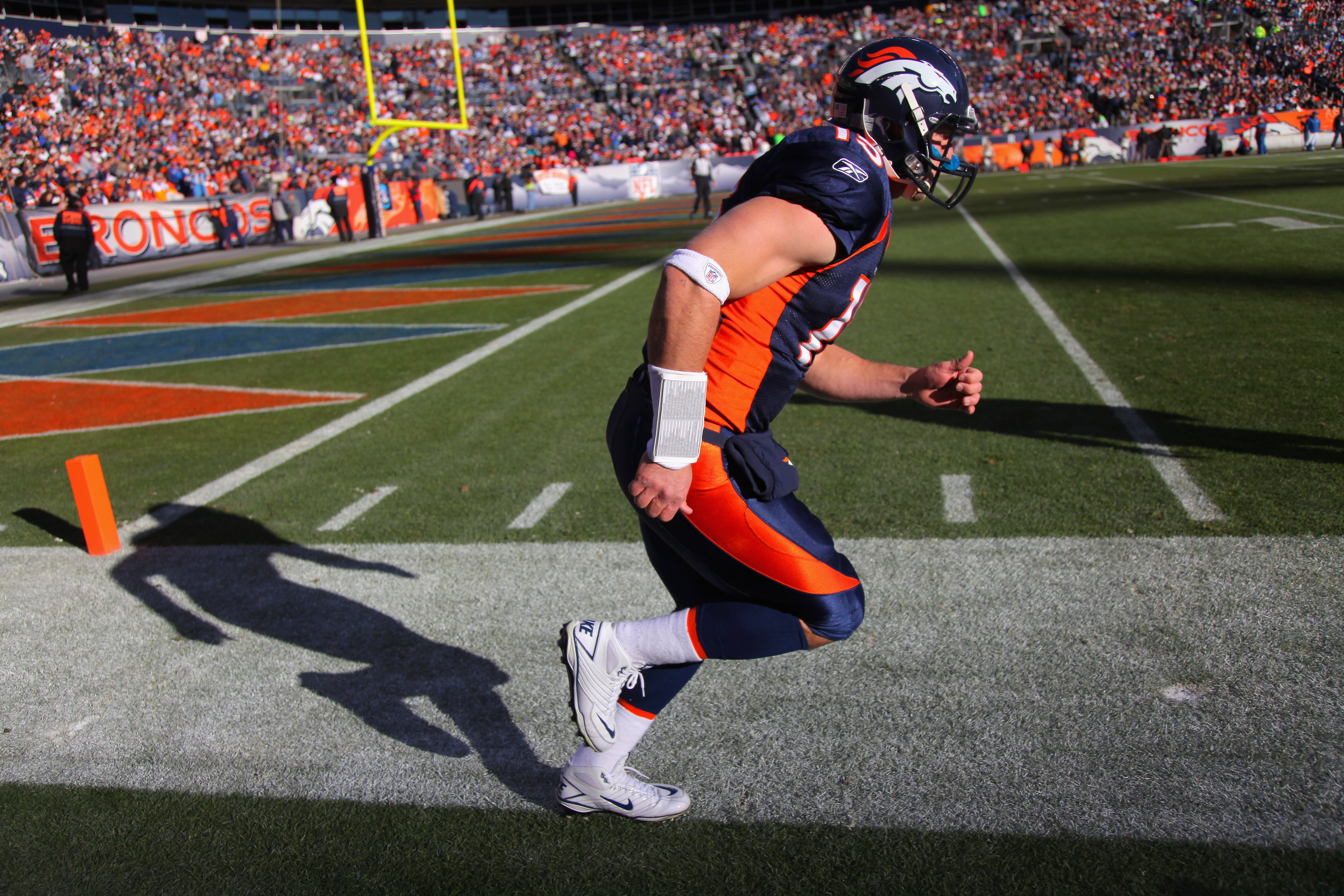 DENVER - JANUARY 02:  Quarterback Tim Tebow #15 of the Denver Broncos warms up prior to facing the San Diego Chargers at INVESCO Field at Mile High on January 2, 2011 in Denver, Colorado.  (Photo by Doug Pensinger/Getty Images)