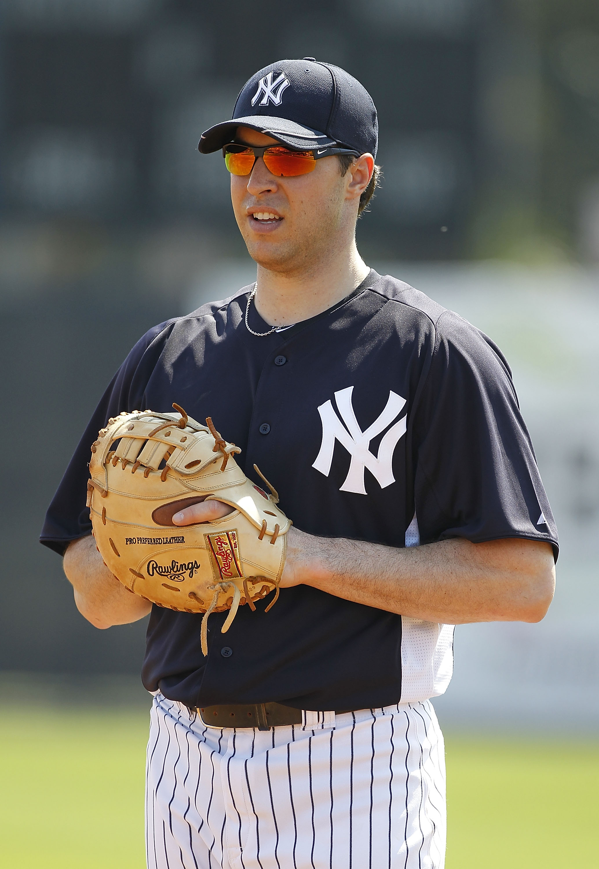 TAMPA, FL - FEBRUARY 20:  Mark Teixeira #25 of the New York Yankees fields ground balls during the first full team workout of Spring Training on February 20, 2011 at the George M. Steinbrenner Field in Tampa, Florida.  (Photo by Leon Halip/Getty Images)