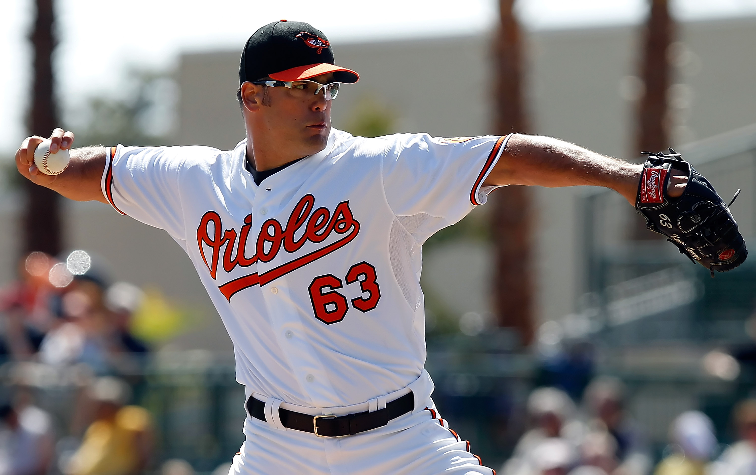 SARASOTA, FL - MARCH 03:  Pitcher Kevin Gregg #63 of the Baltimore Orioles pitches against the Minnesota Twins during a Grapefruit League Spring Training Game at Ed Smith Stadium on March 3, 2011 in Sarasota, Florida.  (Photo by J. Meric/Getty Images)