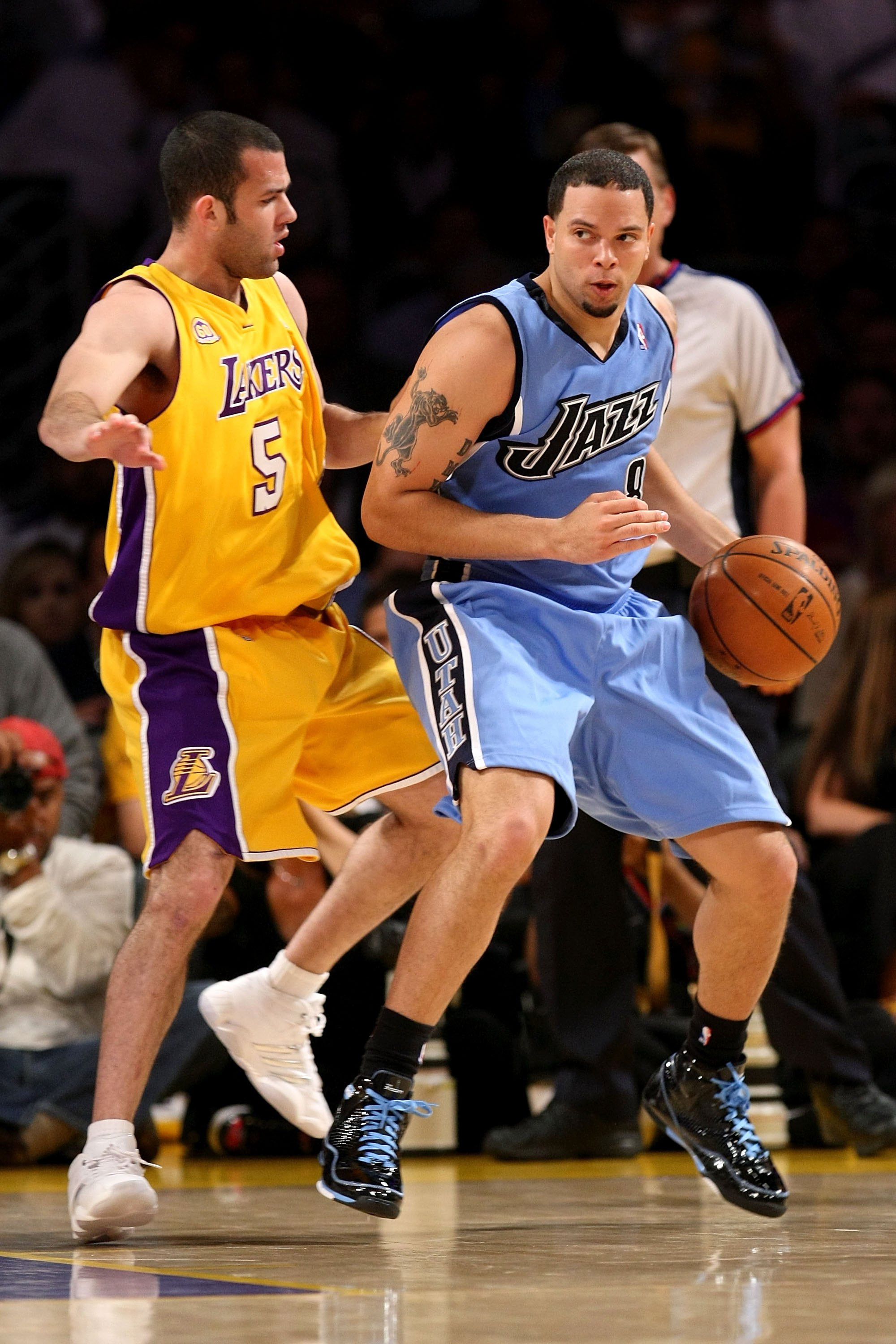 LOS ANGELES, CA - MAY 14:  Deron Williams #8 of the Utah Jazz goes up against Jordan Farmar #5 of the Los Angeles Lakers in Game Five of the Western Conference Semifinals during the 2008 NBA Playoffs on May 14, 2008 at Staples Center in Los Angeles, Calif