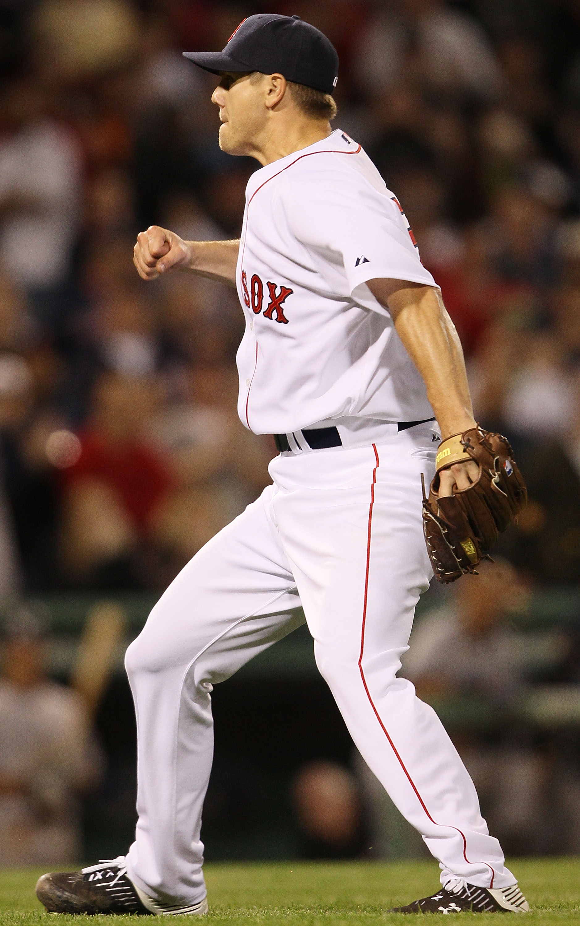BOSTON - APRIL 04:  Jonathan Papelbon #58 of the Boston Red Sox celebrates the last out and the win over the New York Yankees on April 4, 2010 during Opening Night at Fenway Park in Boston, Massachusetts. The Red Sox defeated the Yankees 9-7.  (Photo by E