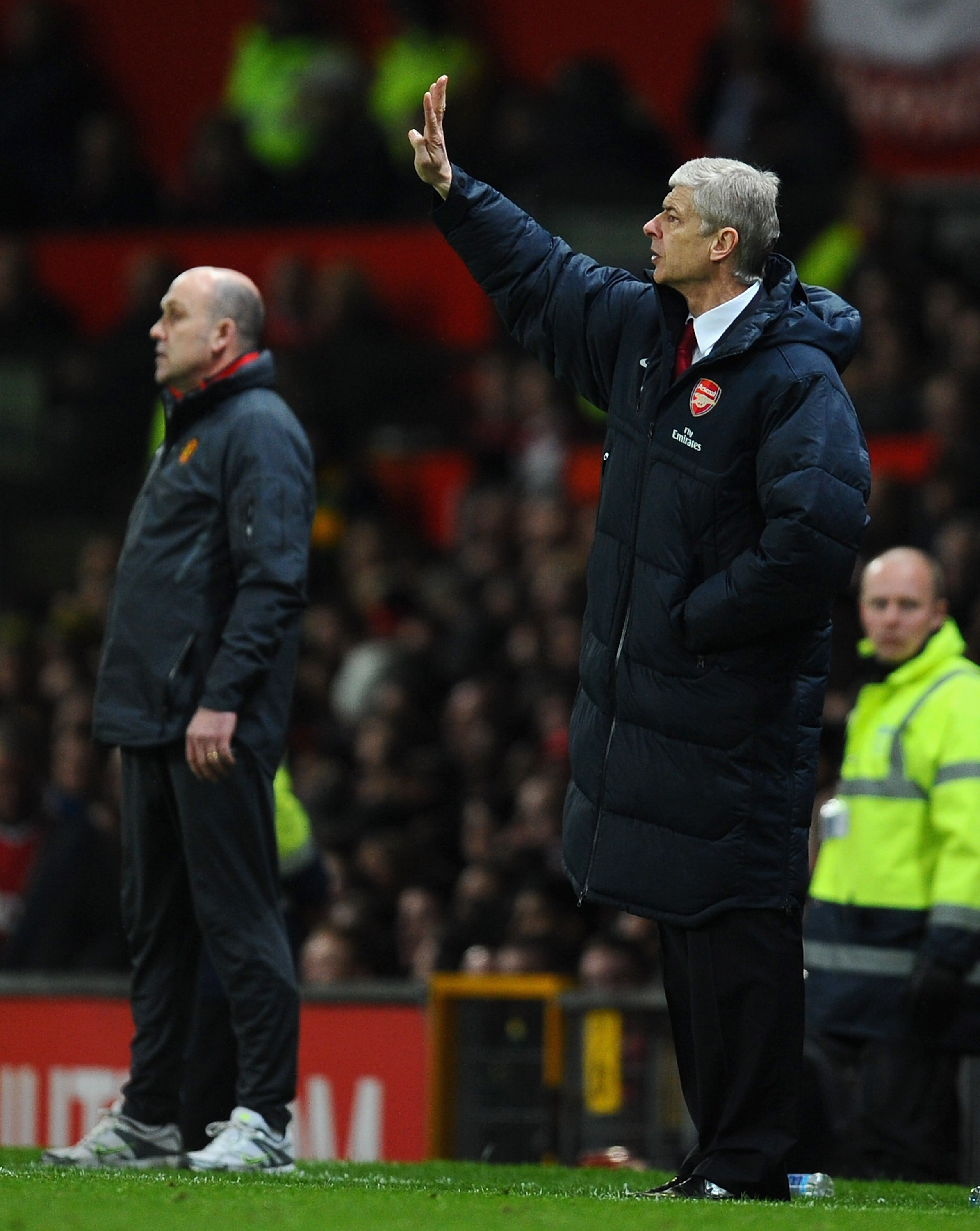 MANCHESTER, ENGLAND - MARCH 12:  Arsenal manager Arsene Wenger directs his team during the FA Cup sponsored by E.On Sixth Round match between Manchester United and Arsenal at Old Trafford on March 12, 2011 in Manchester, England.  (Photo by Clive Mason/Ge