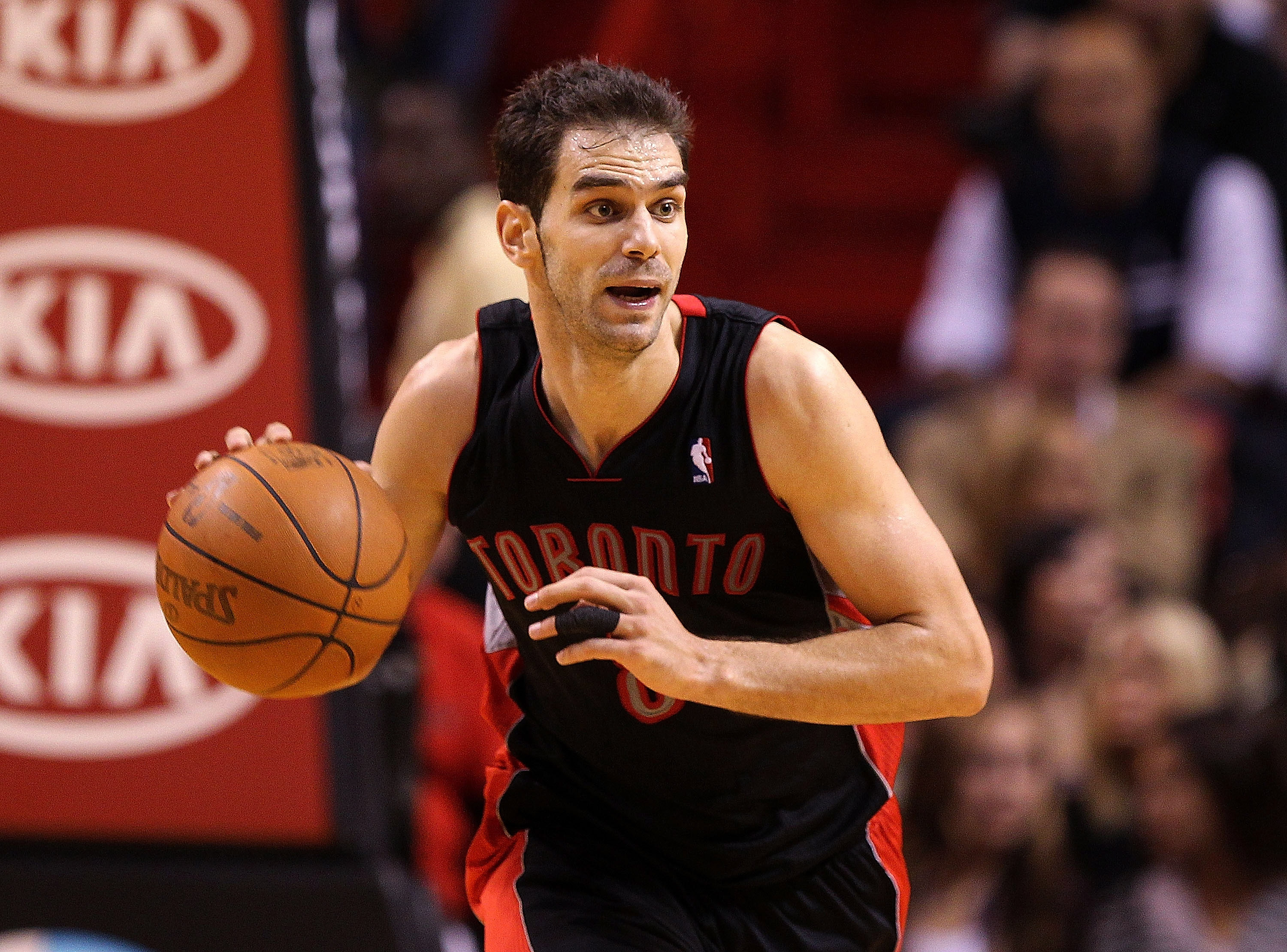MIAMI, FL - JANUARY 22:  Jose Calderon #8 of the Toronto Raptors dribbles the ball during a game against the Miami Heat at American Airlines Arena on January 22, 2011 in Miami, Florida. NOTE TO USER: User expressly acknowledges and agrees that, by downloa