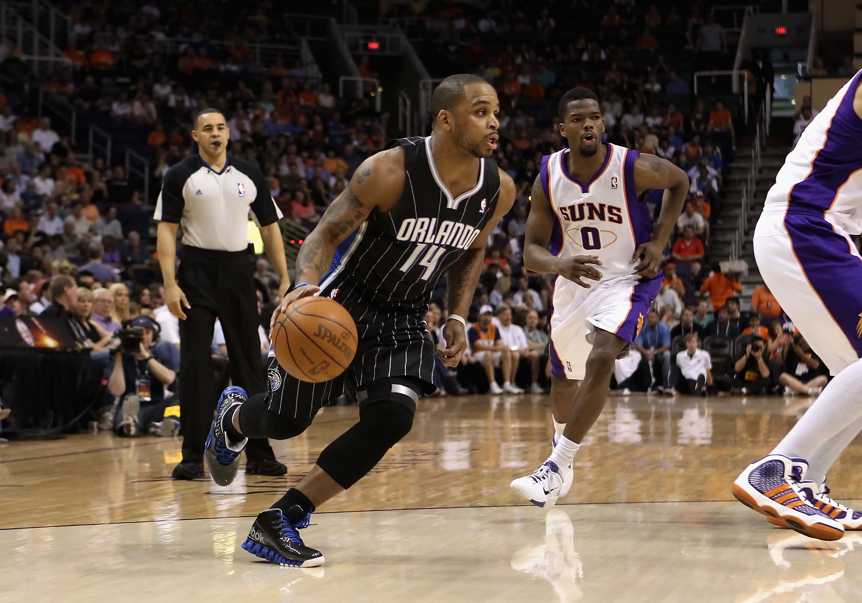 PHOENIX, AZ - MARCH 13:  Jameer Nelson #14 of the Orlando Magic handles the ball during the NBA game against the Phoenix Suns at US Airways Center on March 13, 2011 in Phoenix, Arizona. The Magic defeated the Suns 111-88. NOTE TO USER: User expressly ackn