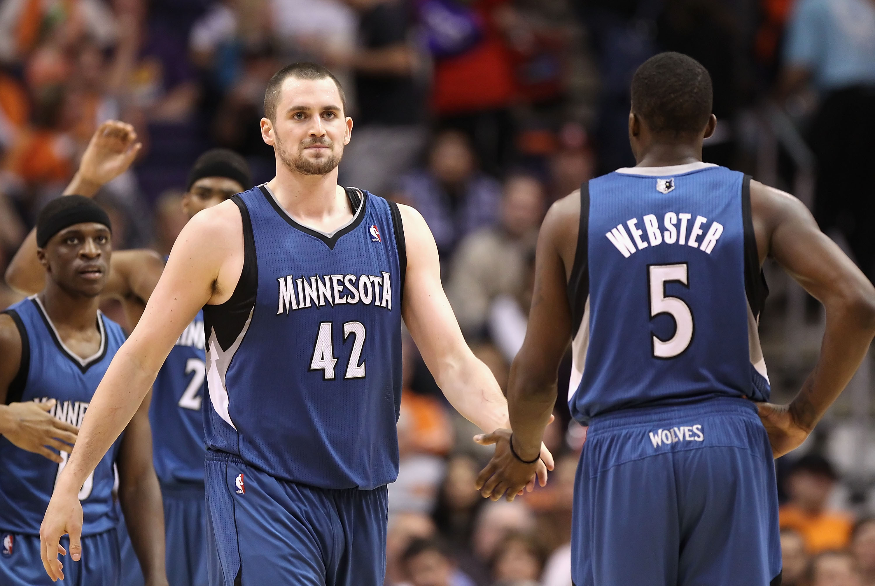 PHOENIX - DECEMBER 15:  Kevin Love #42 of the Minnesota Timberwolves high fives teammate Martell Webster #5 during the NBA game against the Phoenix Suns at US Airways Center on December 15, 2010 in Phoenix, Arizona.  The Suns defeated the Timberwolves 128