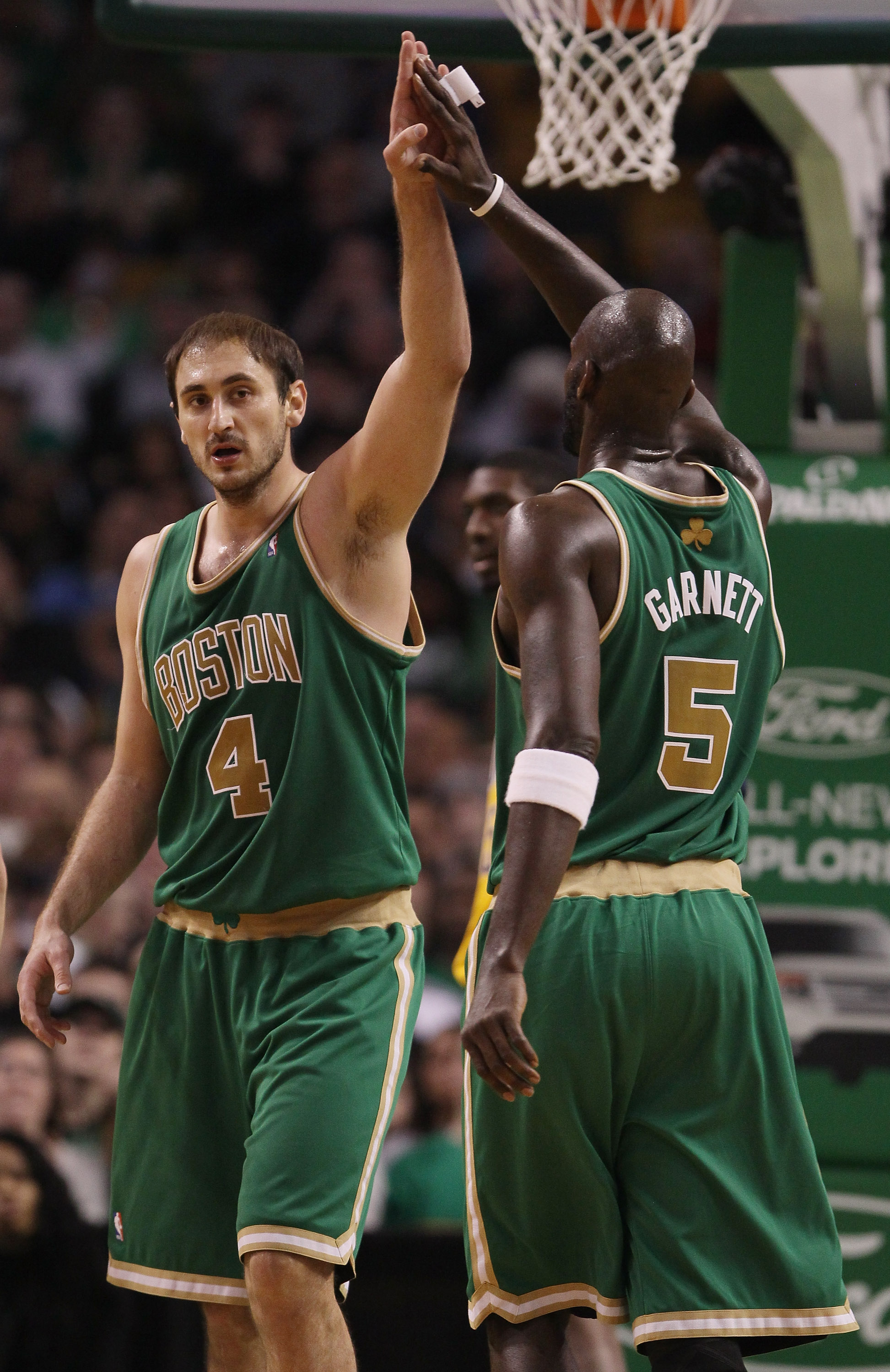 BOSTON, MA - MARCH 16:  Nenad Krstic #4 of the Boston Celtics is congratulated by teammate Kevin Garnett #5 after Krstic drew the foul in the second half against the Indiana Pacers on March 16, 2011 at the TD Garden in Boston, Massachusetts. The Celtics d