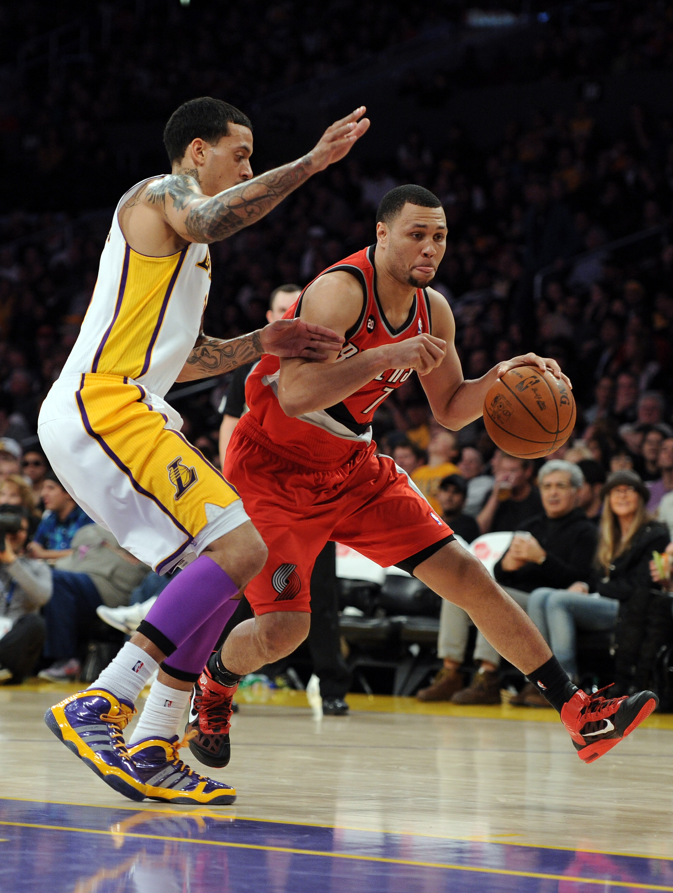 LOS ANGELES, CA - MARCH 20:  Brandon Roy #7 of the Portland Trail Blazers dribbles as he is defended by Matt Barnes #9 of the Los Angeles Lakers at the Staples Center on March 20, 2011 in Los Angeles, California.  NOTE TO USER: User expressly acknowledges
