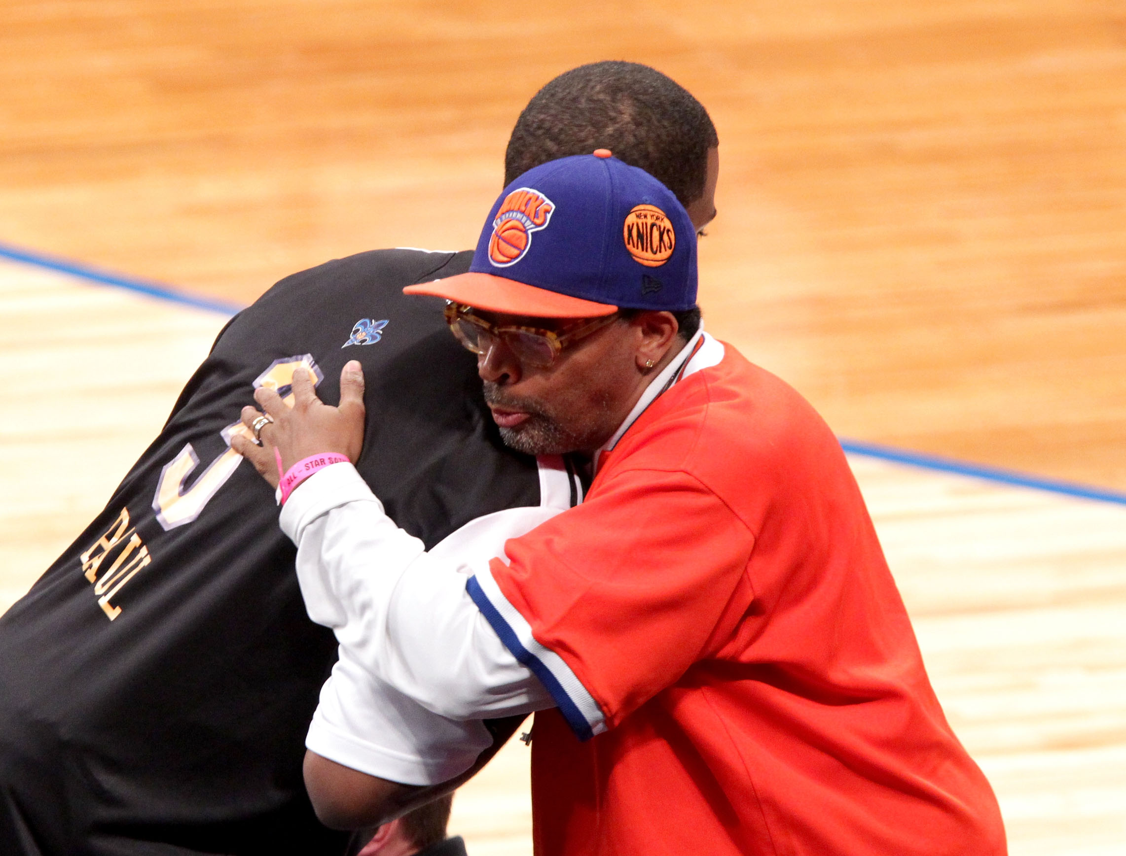 LOS ANGELES, CA - FEBRUARY 19:  NBA player for the New Orleans Hornets (L) and director Spike Lee hug during NBA All-Star Saturday night presented by State Farm at Staples Center on February 19, 2011 in Los Angeles, California.  (Photo by Noel Vasquez/Get