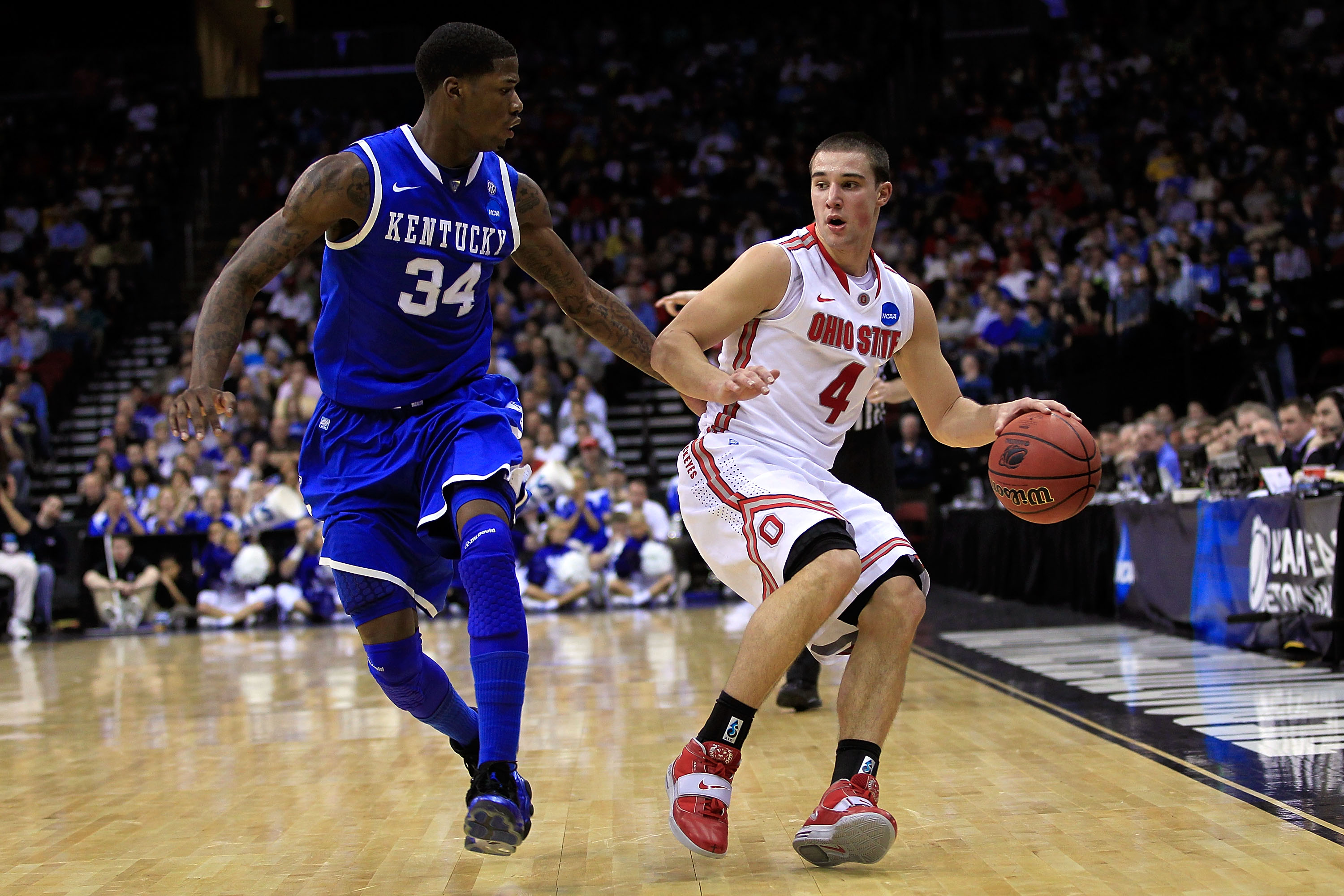 NEWARK, NJ - MARCH 25:  Aaron Craft #4 of the Ohio State Buckeyes brings the ball up court against DeAndre Liggins #34 of the Kentucky Wildcats during the east regional semifinal of the 2011 NCAA Men's Basketball Tournament at the Prudential Center on Mar