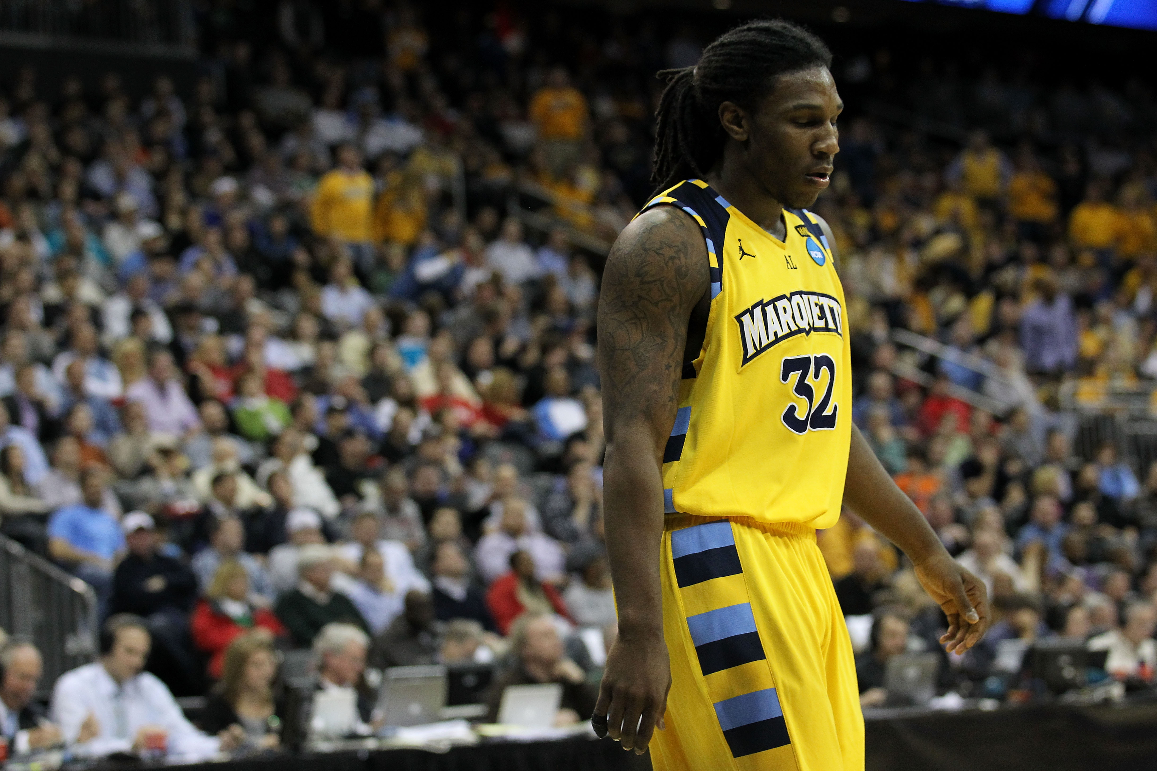 NEWARK, NJ - MARCH 25:  Jae Crowder #32 of the Marquette Golden Eagles reacts after a play against the North Carolina Tar Heels during the east regional semifinal of the 2011 NCAA Men's Basketball Tournament at the Prudential Center on March 25, 2011 in N
