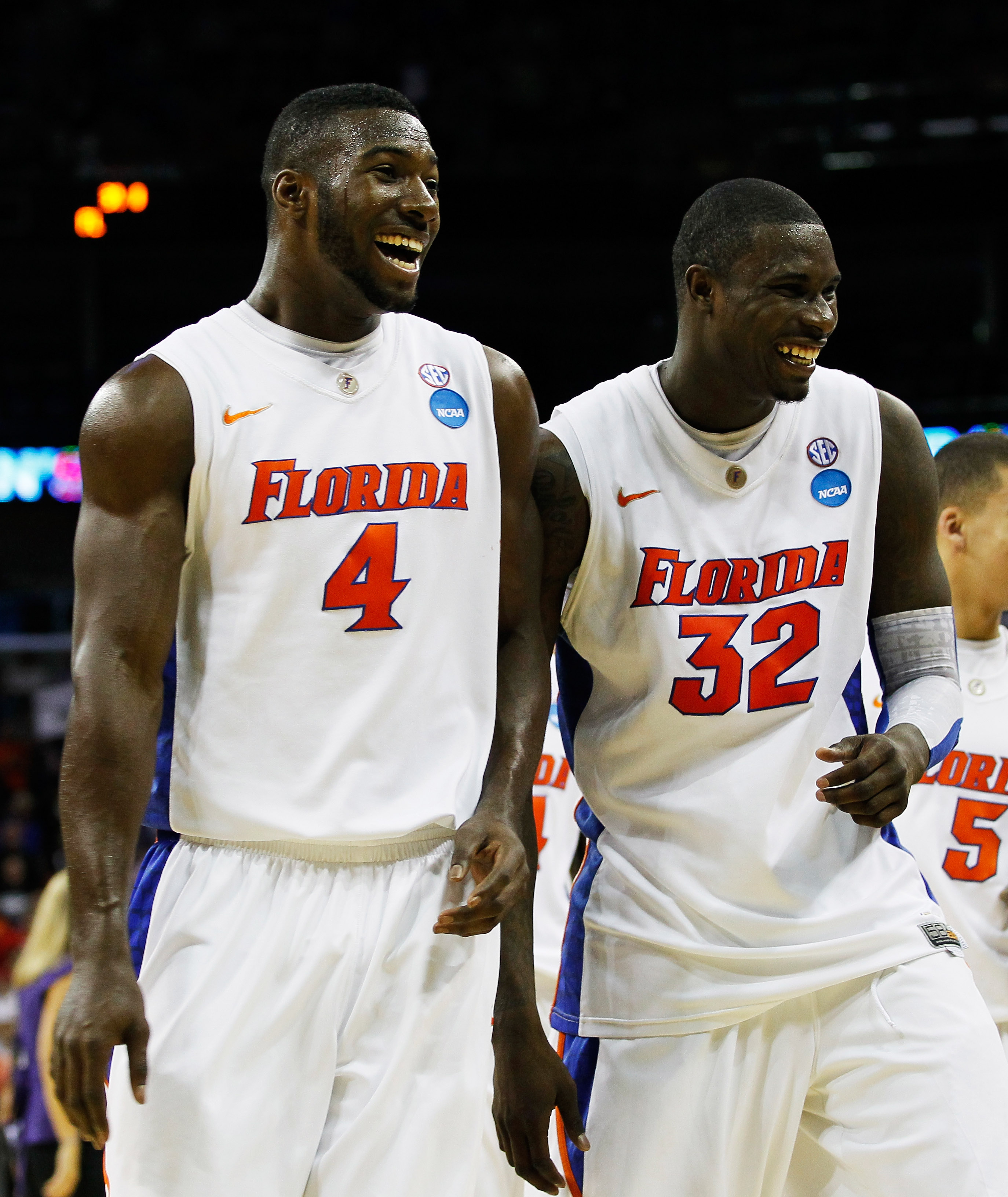 NEW ORLEANS, LA - MARCH 24:  Patric Young #4 and Vernon Macklin #32 of the Florida Gators celebrate durig their 83 to 74 win over the Brigham Young Cougars during the Southeast regional of the 2011 NCAA men's basketball tournament at New Orleans Arena on