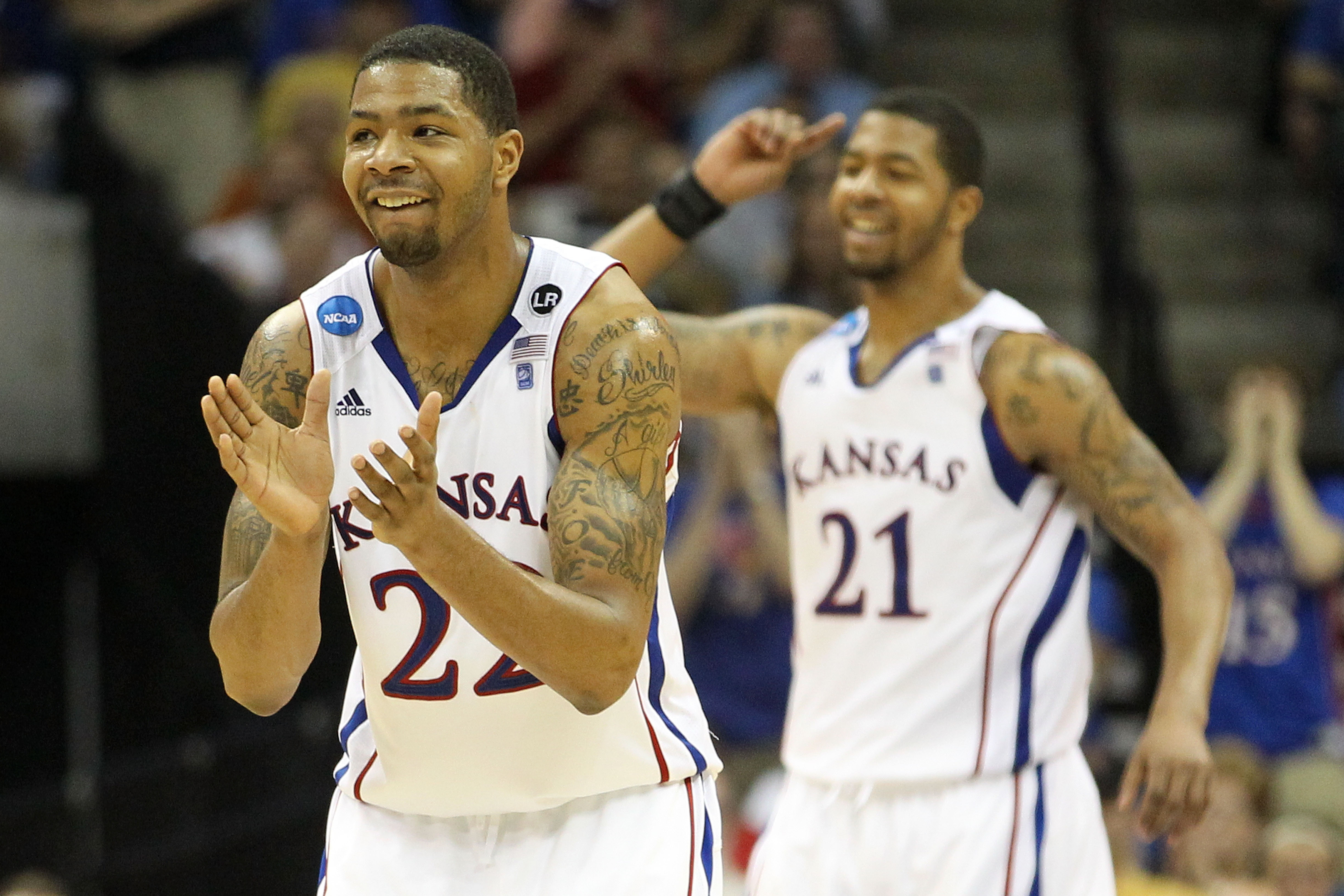 TULSA, OK - MARCH 20:  Marcus Morris #22 and Markieff Morris #21 of the Kansas Jayhawks celebrate after a play against the Illinois Fighting Illini during the third round of the 2011 NCAA men's basketball tournament at BOK Center on March 20, 2011 in Tuls