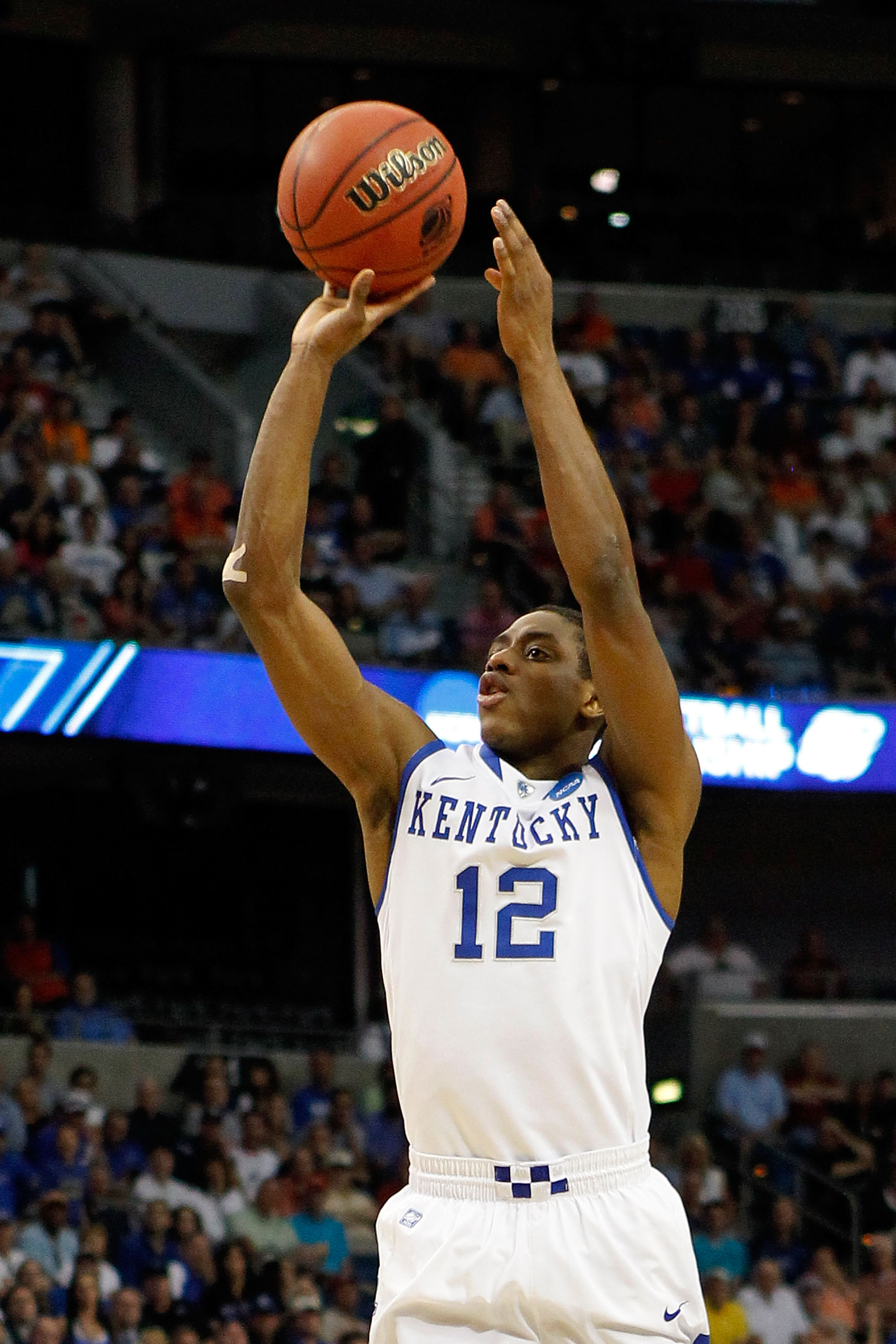 TAMPA, FL - MARCH 19:  Brandon Knight #12 of the Kentucky Wildcats attempts a shot against the West Virginia Mountaineers during the third round of the 2011 NCAA men's basketball tournament at St. Pete Times Forum on March 19, 2011 in Tampa, Florida. Kent