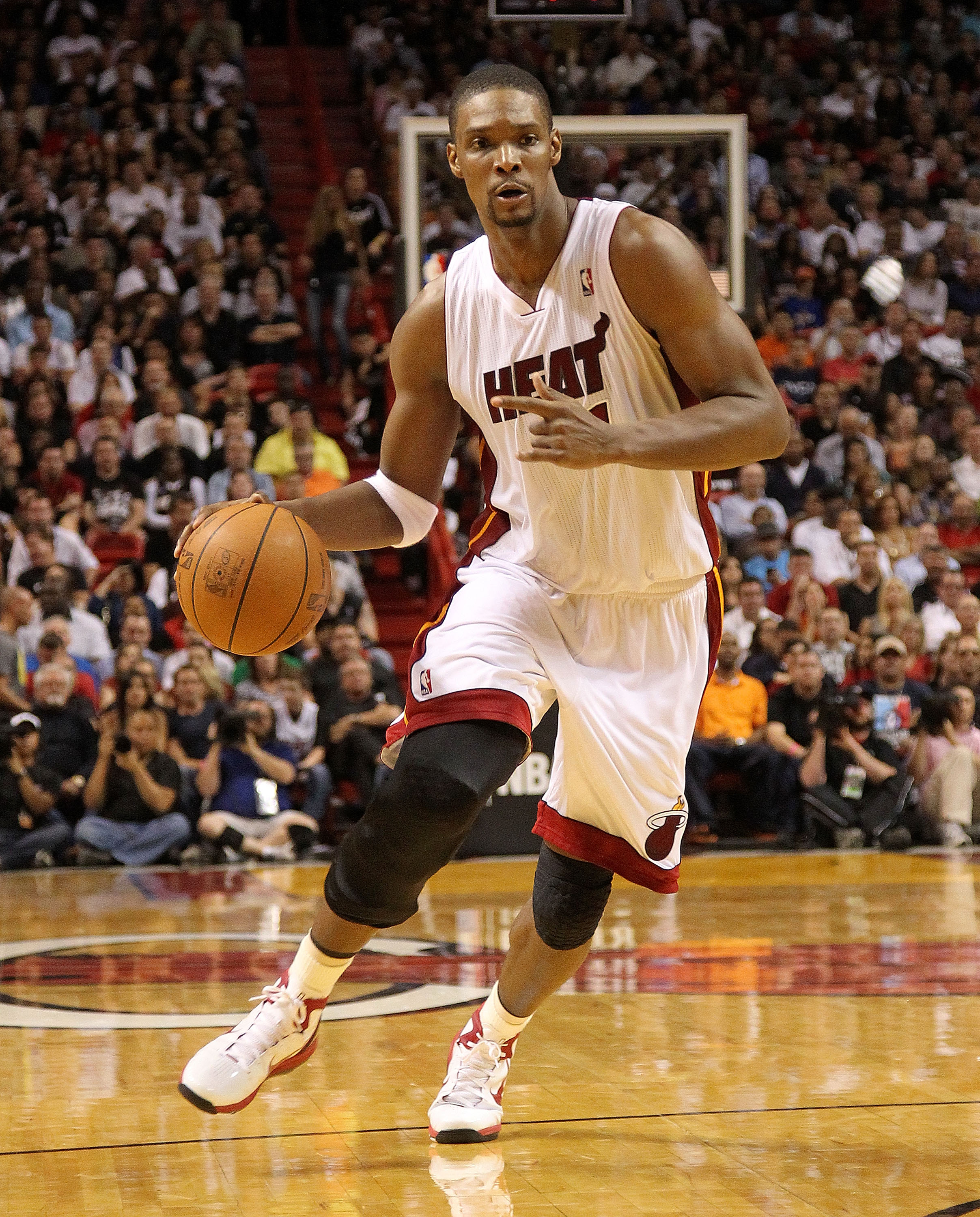 MIAMI, FL - FEBRUARY 27: Chris Bosh #1 of the Miami Heat drives during a game gainst the New York Knicks at American Airlines Arena on February 27, 2011 in Miami, Florida. NOTE TO USER: User expressly acknowledges and agrees that, by downloading and/or us
