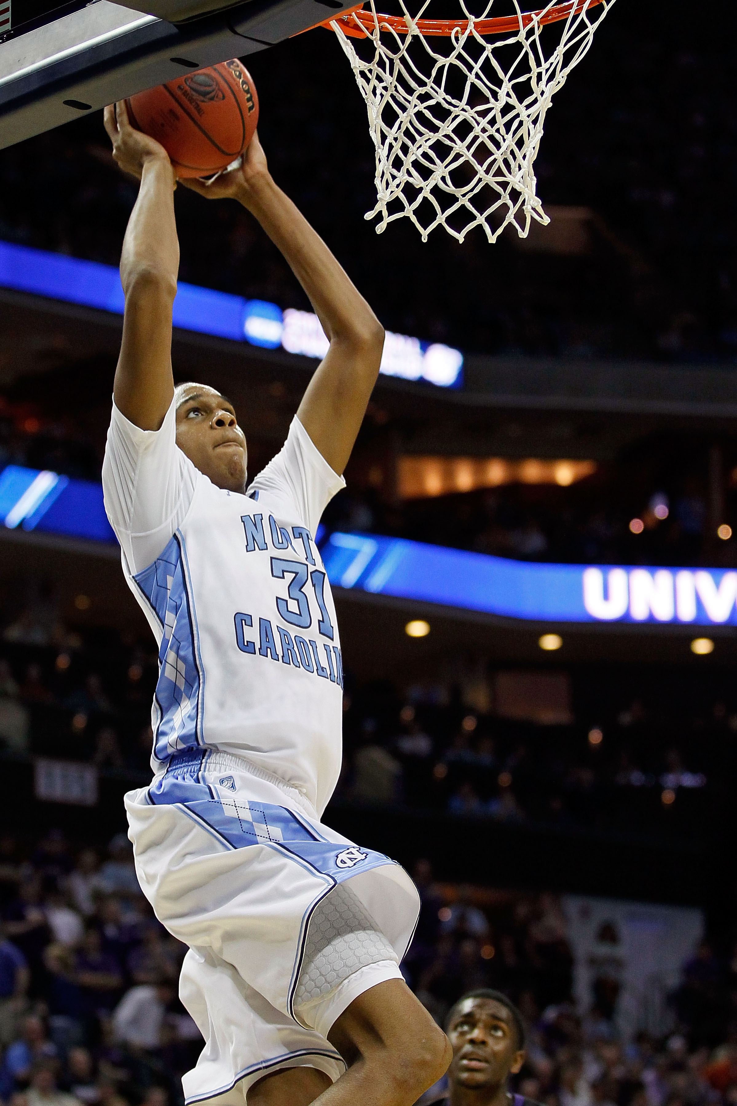CHARLOTTE, NC - MARCH 20:  John Henson #31 of the North Carolina Tar Heels goes up to dunk the ball while taking on the Michigan Wolverines during the third round of the 2011 NCAA men's basketball tournament at Time Warner Cable Arena on March 20, 2011 in