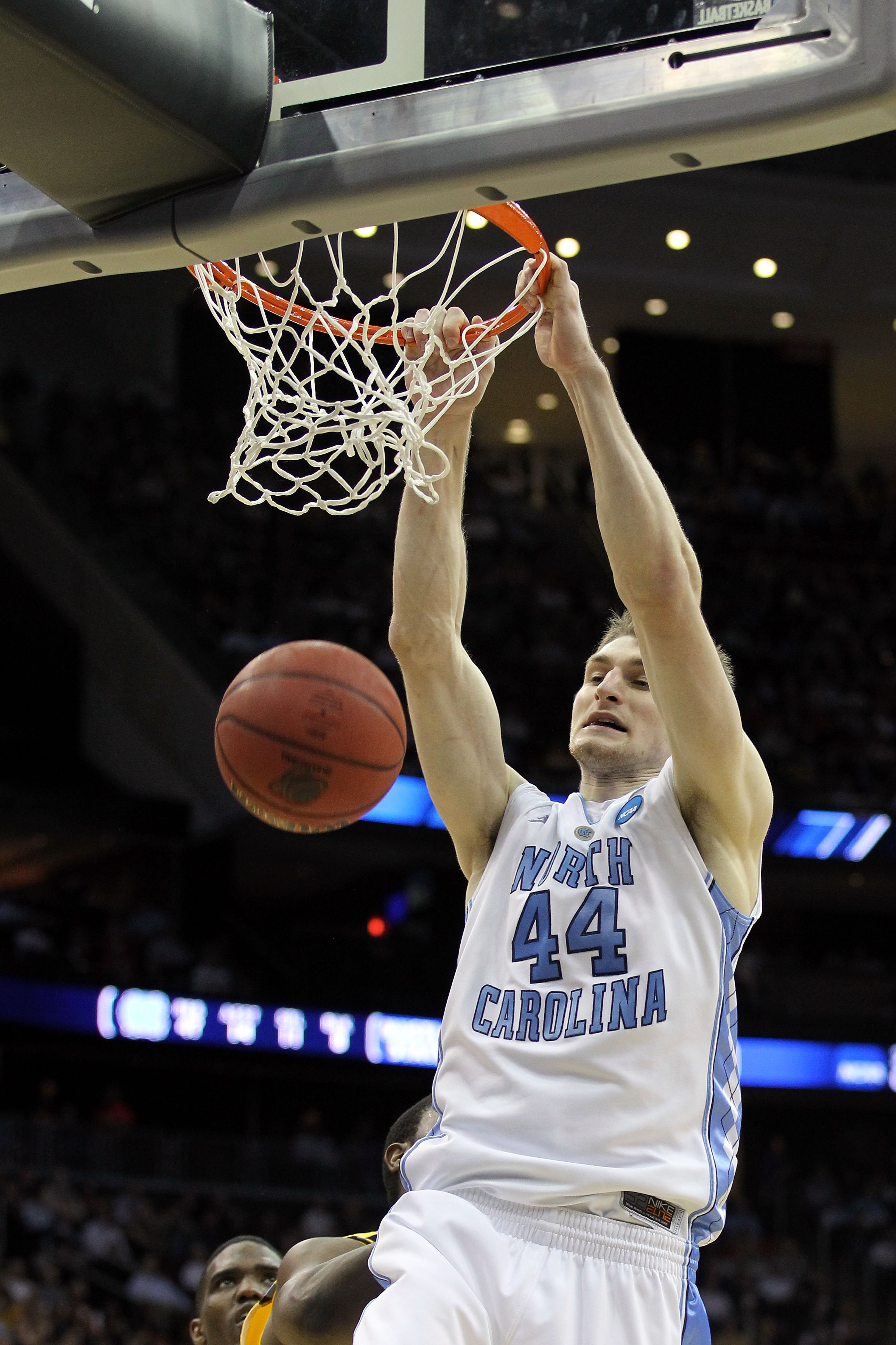 NEWARK, NJ - MARCH 25:  Tyler Zeller #44 of the North Carolina Tar Heels dunks against the Marquette Golden Eagles during the second half of the east regional semifinal of the 2011 NCAA Men's Basketball Tournament at the Prudential Center on March 25, 201