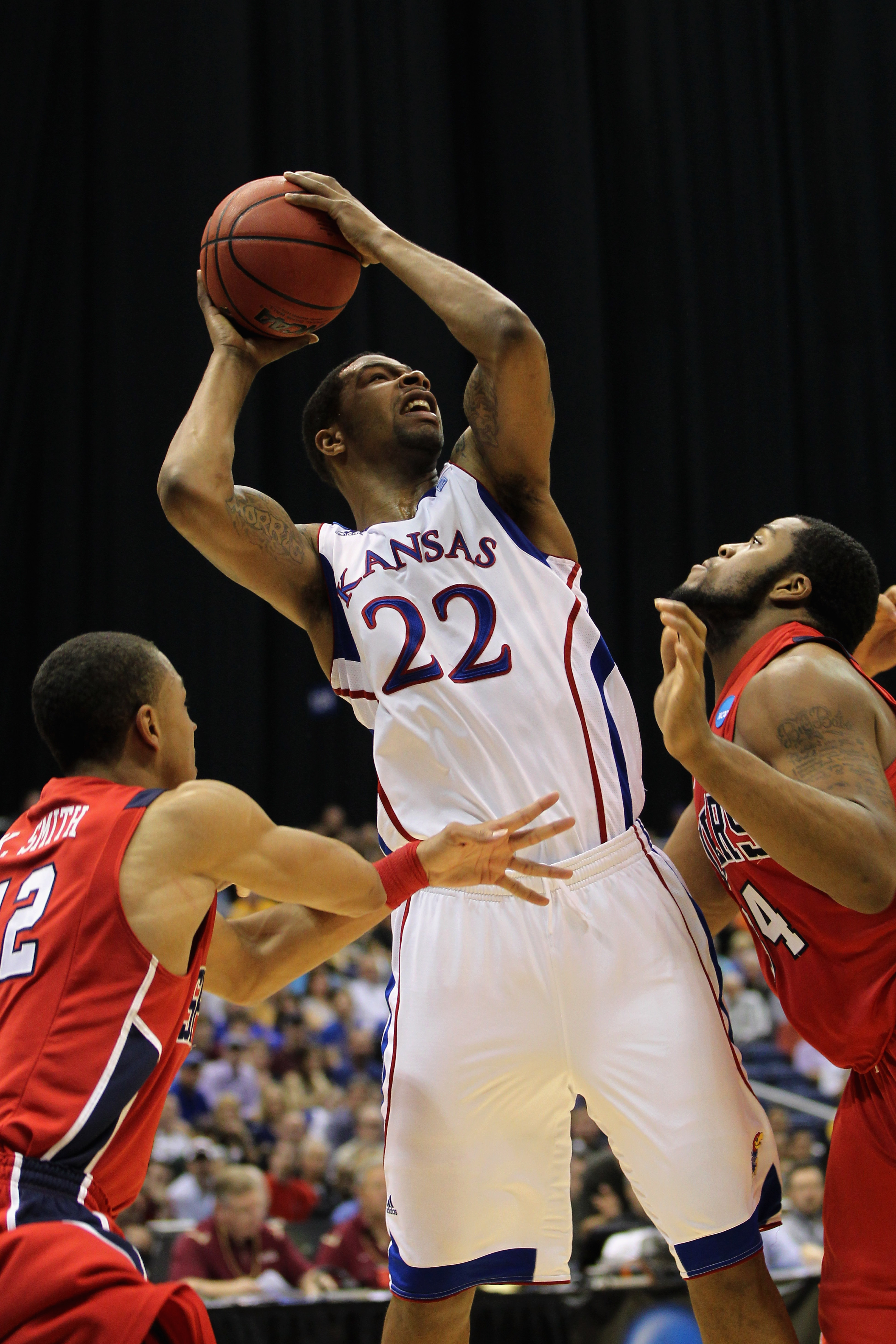 SAN ANTONIO, TX - MARCH 25:  Marcus Morris #22 of the Kansas Jayhawks shoots against the Richmond Spiders during the southwest regional of the 2011 NCAA men's basketball tournament at the Alamodome on March 25, 2011 in San Antonio, Texas.  (Photo by Jamie