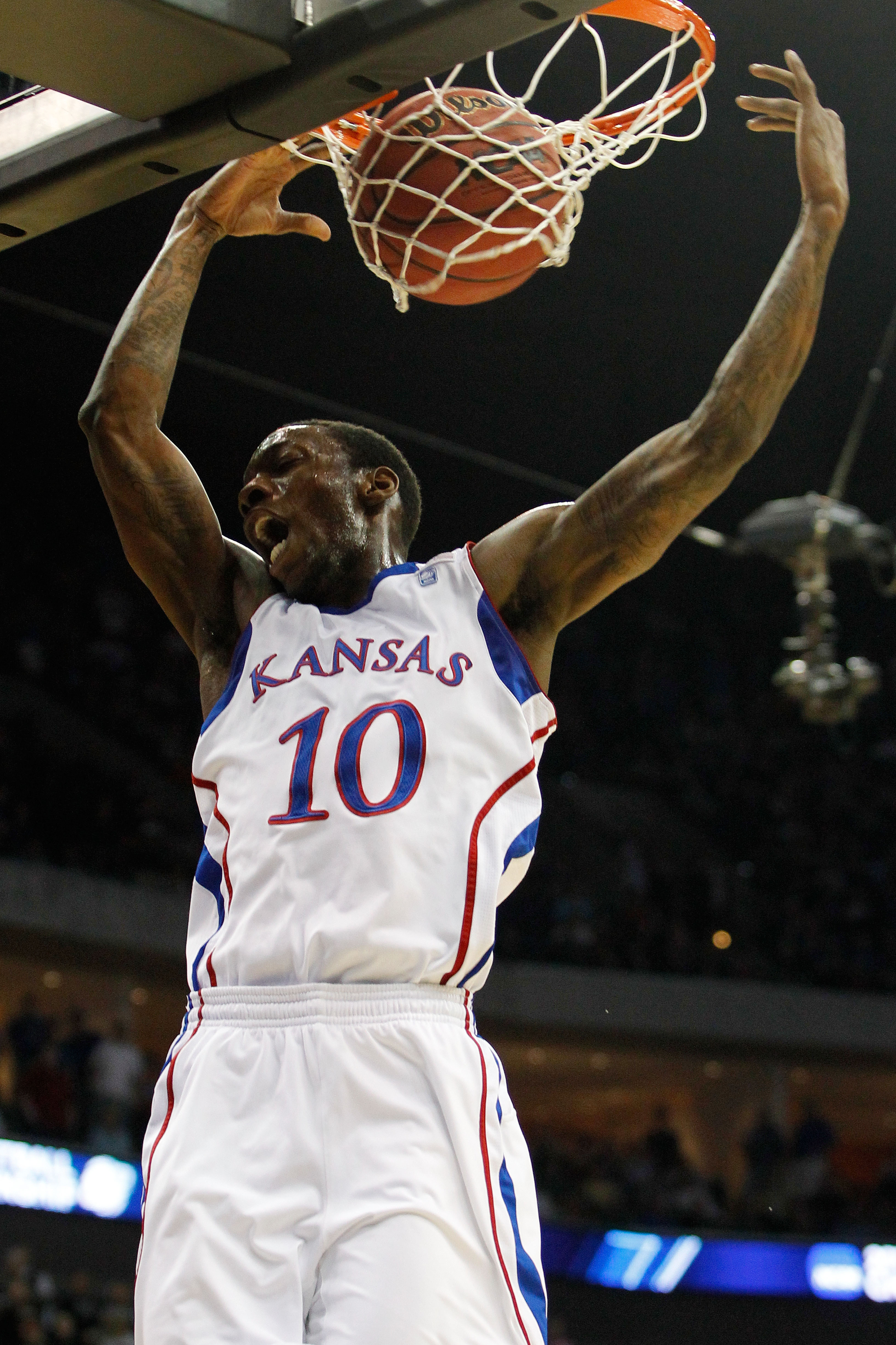 TULSA, OK - MARCH 20:  Tyshawn Taylor #10 of the Kansas Jayhawks dunks the ball against the Illinois Fighting Illini during the third round of the 2011 NCAA men's basketball tournament at BOK Center on March 20, 2011 in Tulsa, Oklahoma.  (Photo by Tom Pen