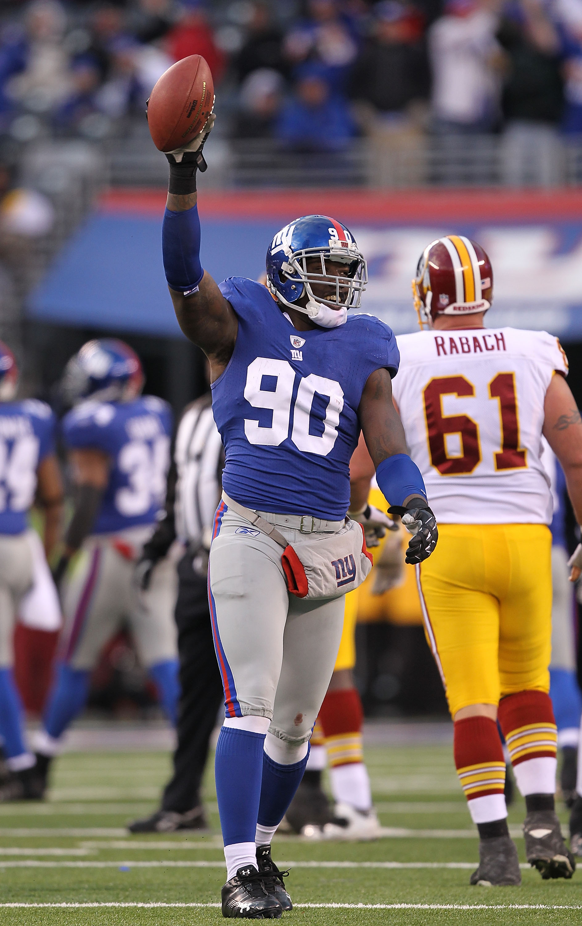EAST RUTHERFORD, NJ - DECEMBER 05:  Jason Pierre-Paul #90 of the New York Giants celebrates running back a fumble by the Washington Redskins during their game on December 5, 2010 at The New Meadowlands Stadium in East Rutherford, New Jersey.  (Photo by Al