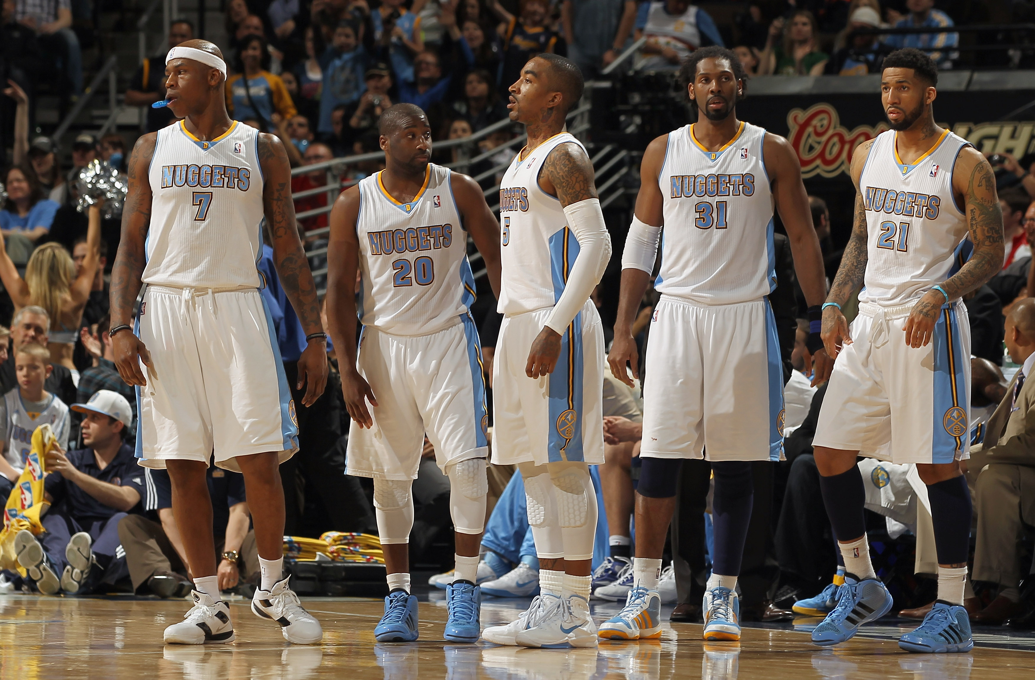 DENVER, CO - MARCH 23:  (L-R) Al Harrington #7, Raymond Felton #20, J.R. Smith #5, Nene #31 and Wilson Chandler #21 of the Denver Nuggets head back to the court after a time out against the San Antonio Spurs at the Pepsi Center on March 23, 2011 in Denver
