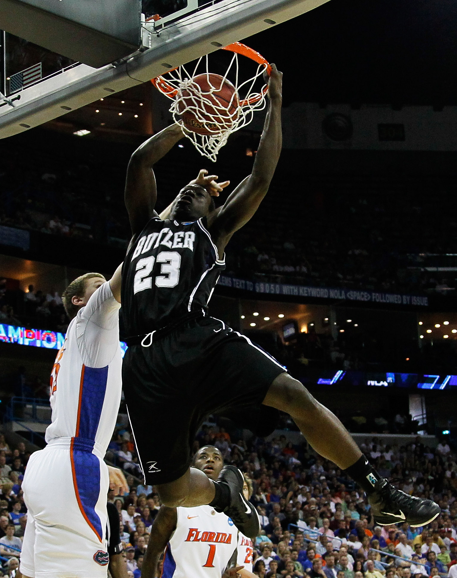 NEW ORLEANS, LA - MARCH 26:  Khyle Marshall #23 of the Butler Bulldogs dunks over Erik Murphy #33 of the Florida Gators in the first half during the Southeast regional final of the 2011 NCAA men's basketball tournament at New Orleans Arena on March 26, 20