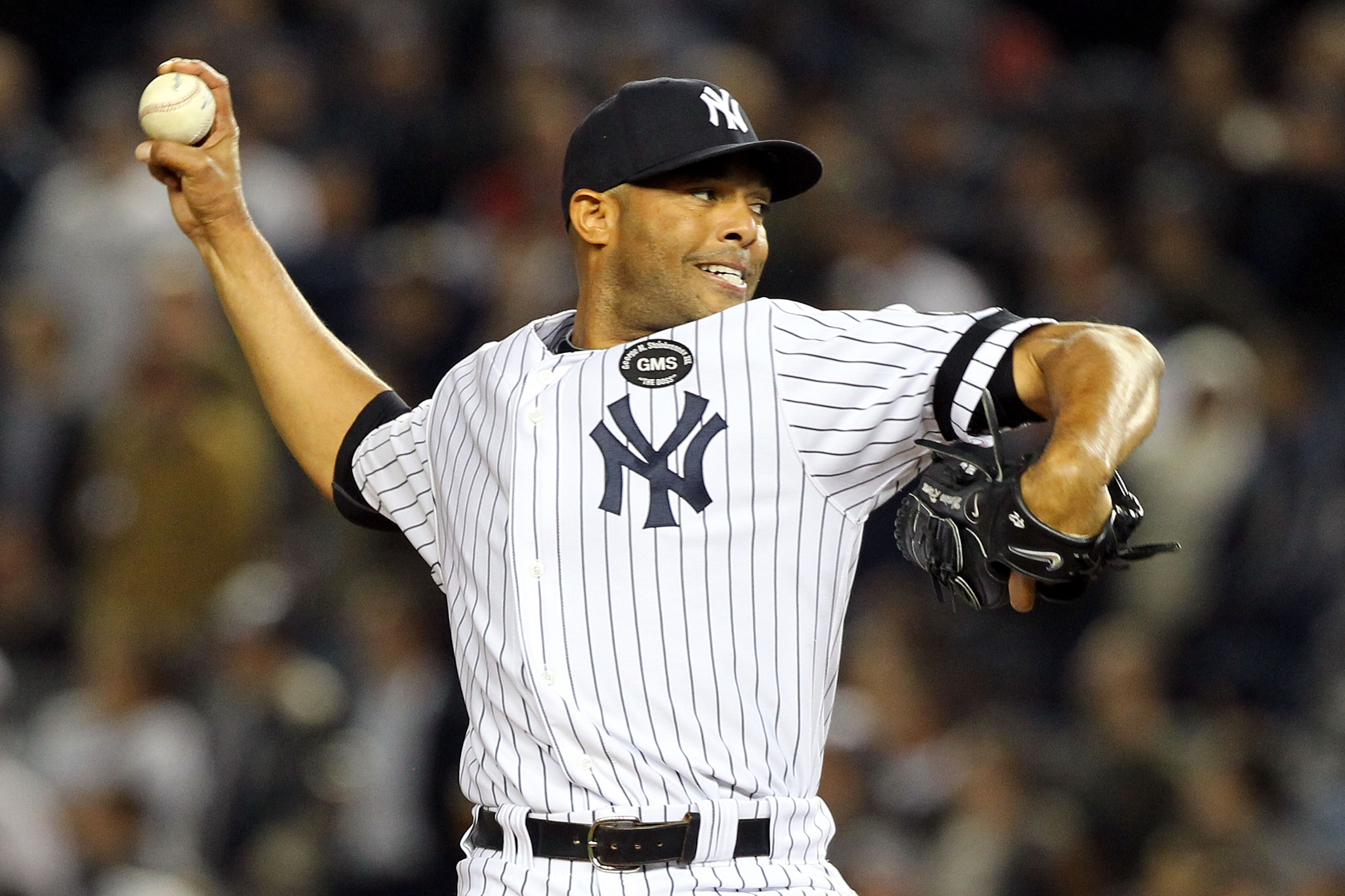 NEW YORK - OCTOBER 20:  Mariano Rivera #42 of the New York Yankees pitches against the Texas Rangers in Game Five of the ALCS during the 2010 MLB Playoffs at Yankee Stadium on October 20, 2010 in the Bronx borough of New York City.  (Photo by Al Bello/Get