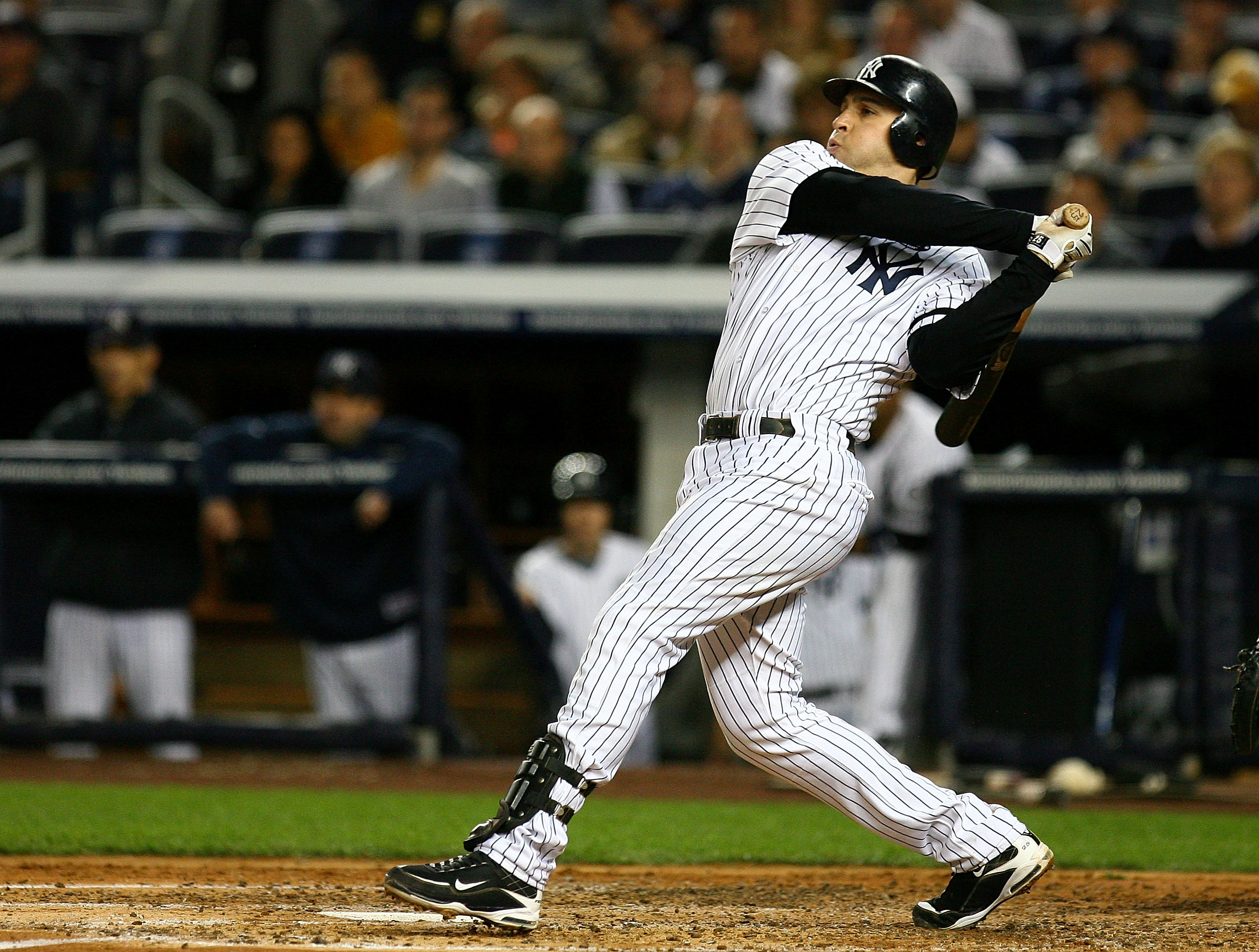 NEW YORK - OCTOBER 09:  Mark Teixeira #25 of the New York Yankees hits a RBI single in the bottom of the third inning against the Minnesota Twins during Game Three of the ALDS part of the 2010 MLB Playoffs at Yankee Stadium on October 9, 2010 in the Bronx