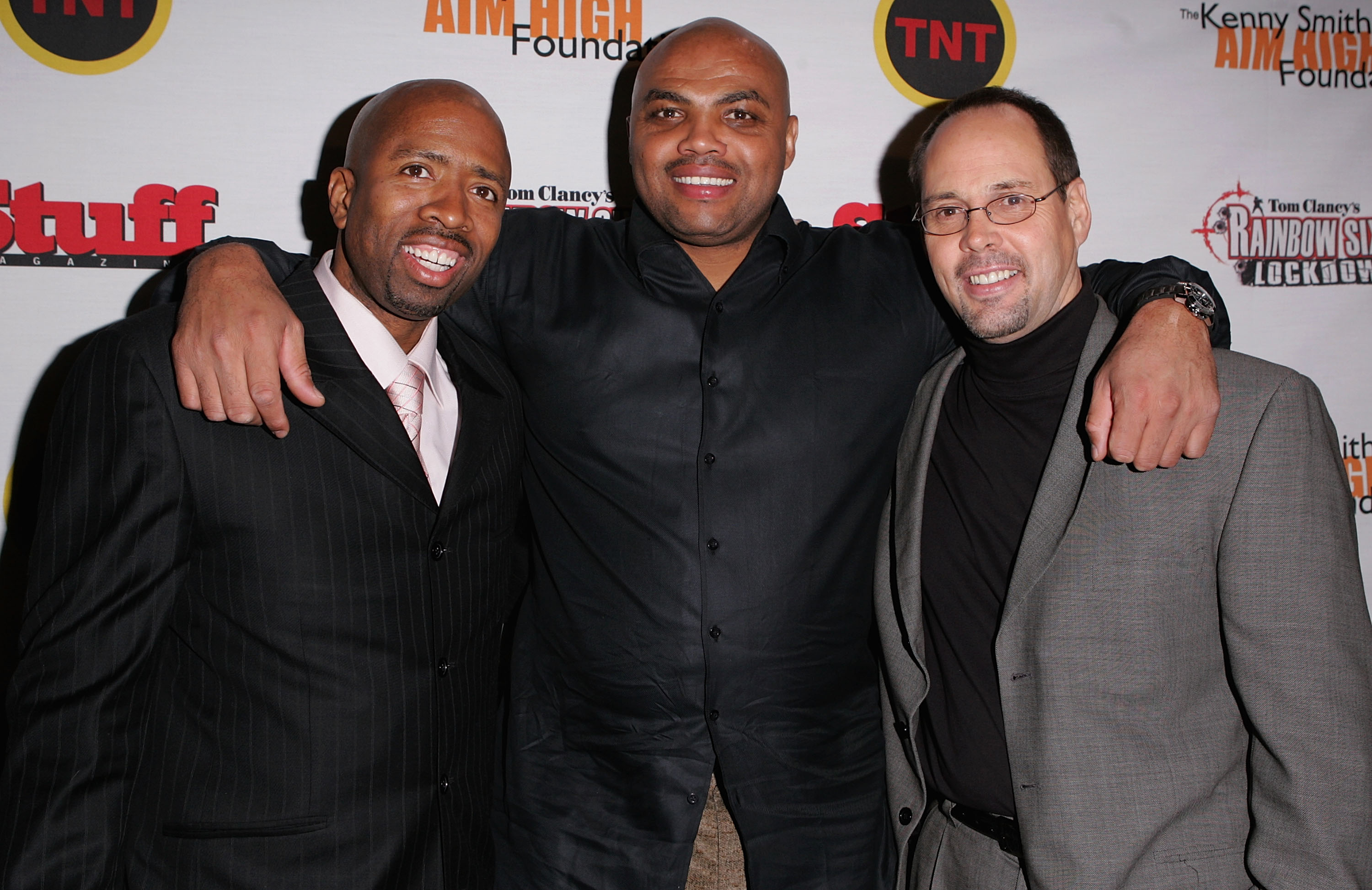 DENVER - FEBRUARY 18:  Kenny Smith, Charles Barkley and guest arrive at Kenny Smith's 2005 All-Star Party on February 18, 2005 in Denver, Colorado.  (Photo By Mark Mainz/Getty Images)