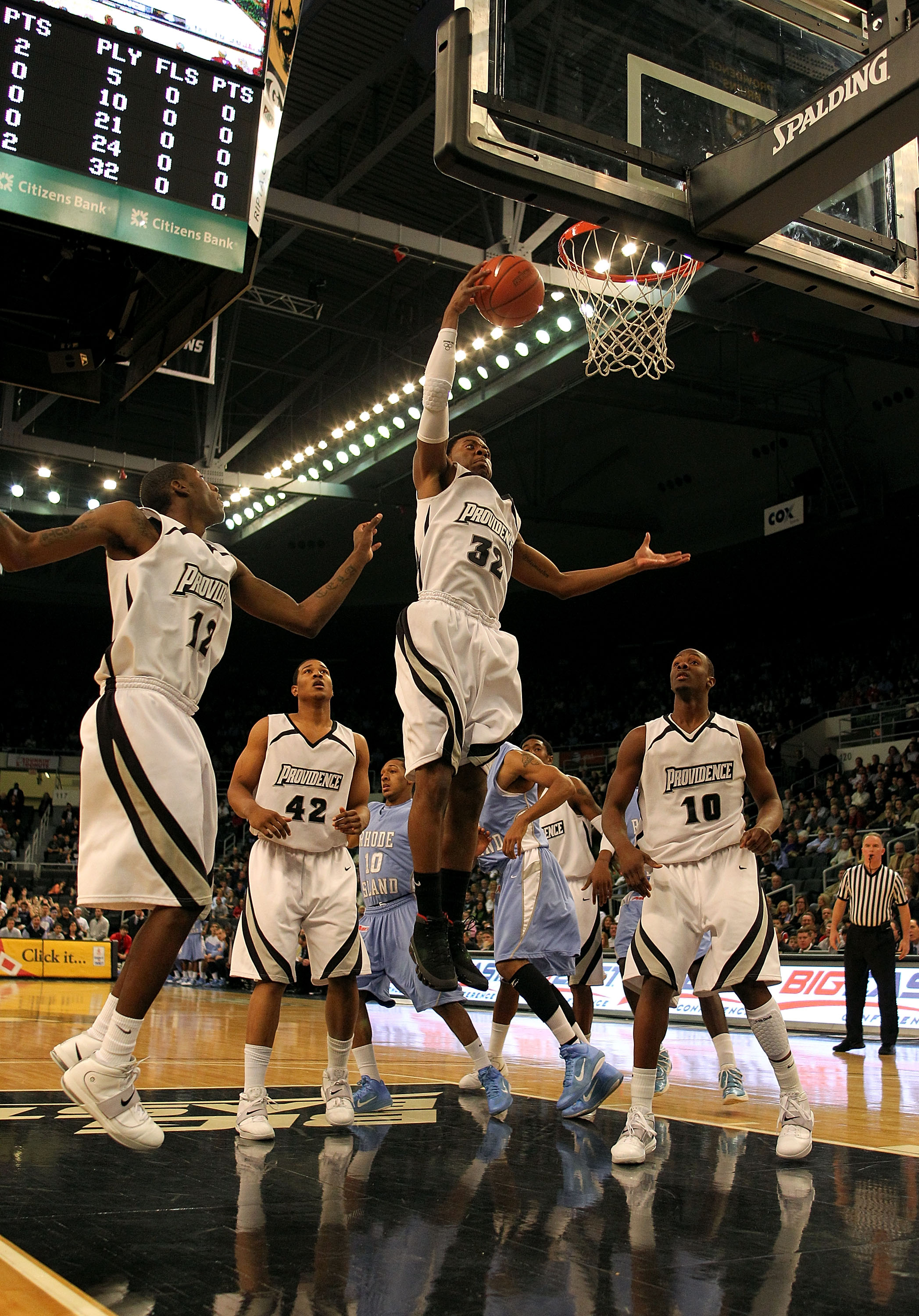PROVIDENCE, RI - DECEMBER 04:  Vincent Council #32 of the Providence Friars controls a rebound against the Rhode Island Rams at the Dunkin' Donuts Center on December 4, 2010 in Providence, Rhode Island.  (Photo by Chris Chambers/Getty Images)