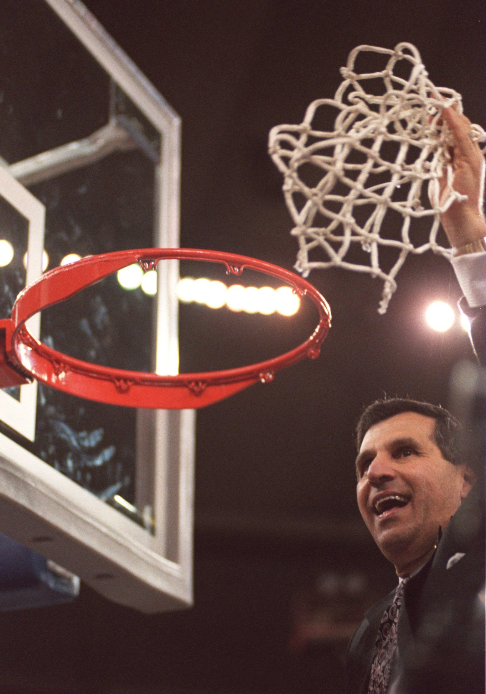 3 APR 1995:  UCLA  COACH JIM HARRICK CELEBRATES AFTER DEFEATING ARKANSAS 89-78 IN THE NCAA MEN''S BASKETBALL CHAMPIONSHIP TONIGHT AT THE KINGDOME IN SEATTLE, WASHINGTON.    Mandatory Credit: Stephen Dunn/ALLSPORT