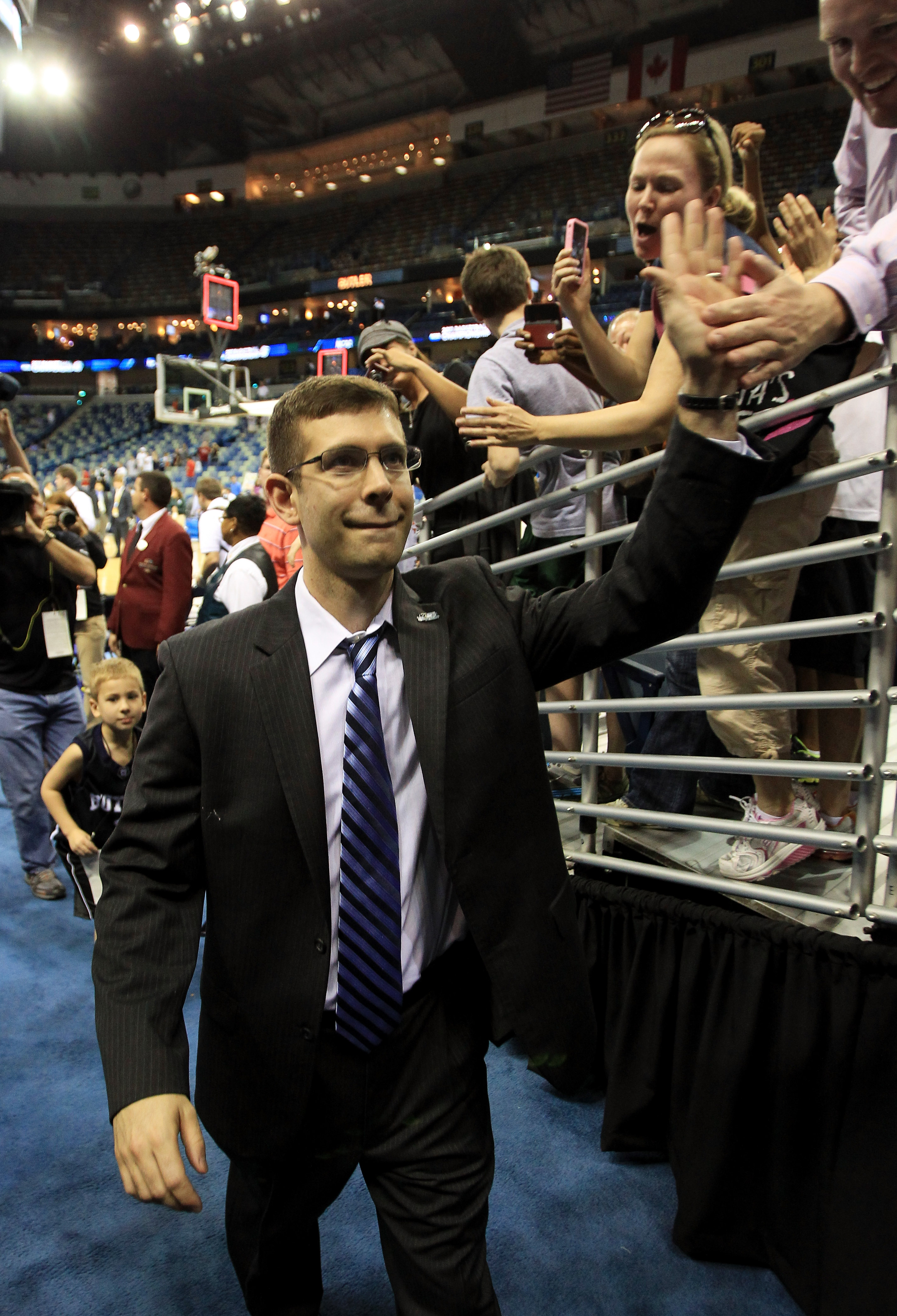NEW ORLEANS, LA - MARCH 26:  Head coach Brad Stevens of the Butler Bulldogs celebrates with fans after they defeated the Florida Gators 74 to 71 in overtime during the Southeast regional final of the 2011 NCAA men's basketball tournament at New Orleans Ar