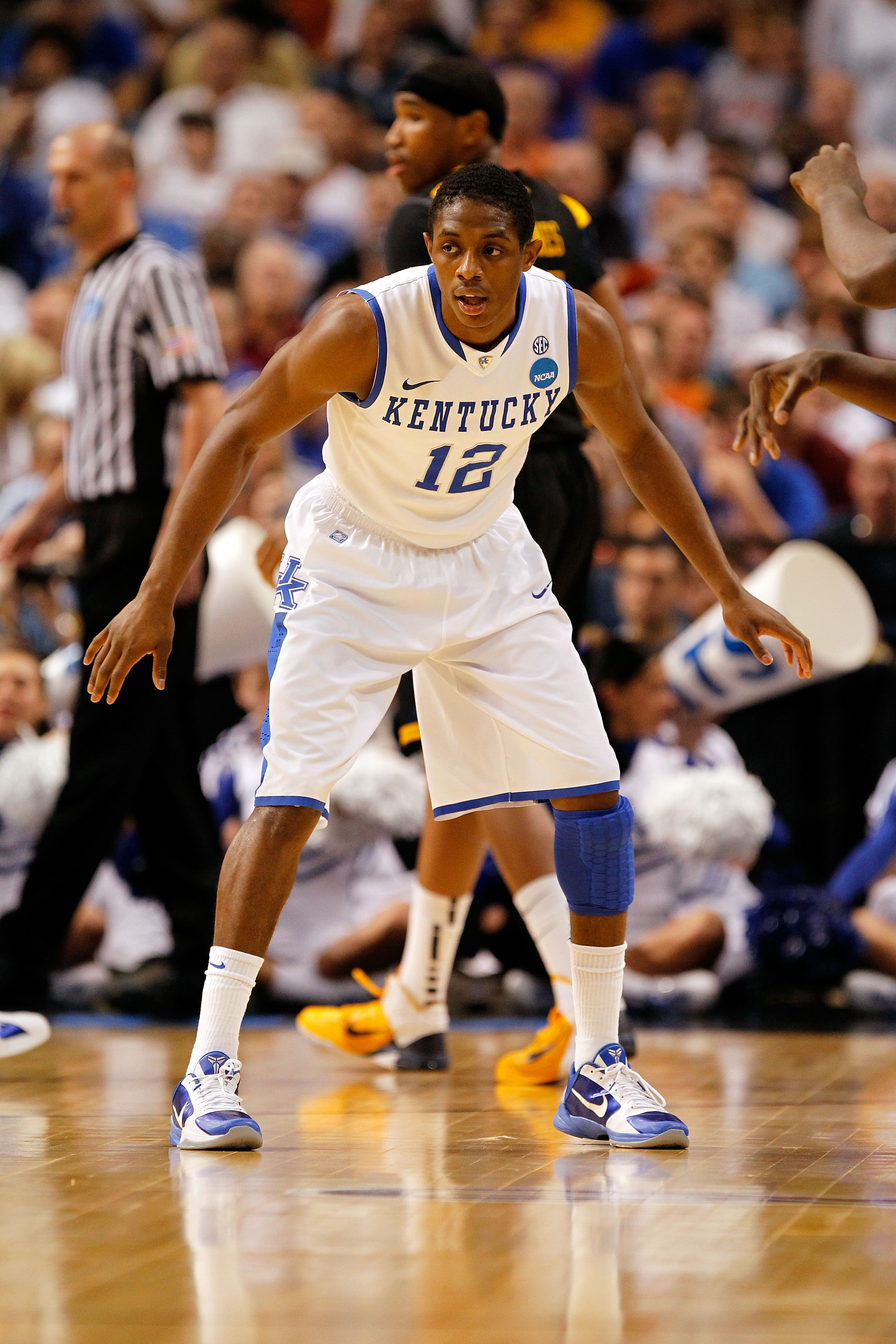 TAMPA, FL - MARCH 19:  Brandon Knight #12 of the Kentucky Wildcats defends against the West Virginia Mountaineers during the third round of the 2011 NCAA men's basketball tournament at St. Pete Times Forum on March 19, 2011 in Tampa, Florida. Kentucky won