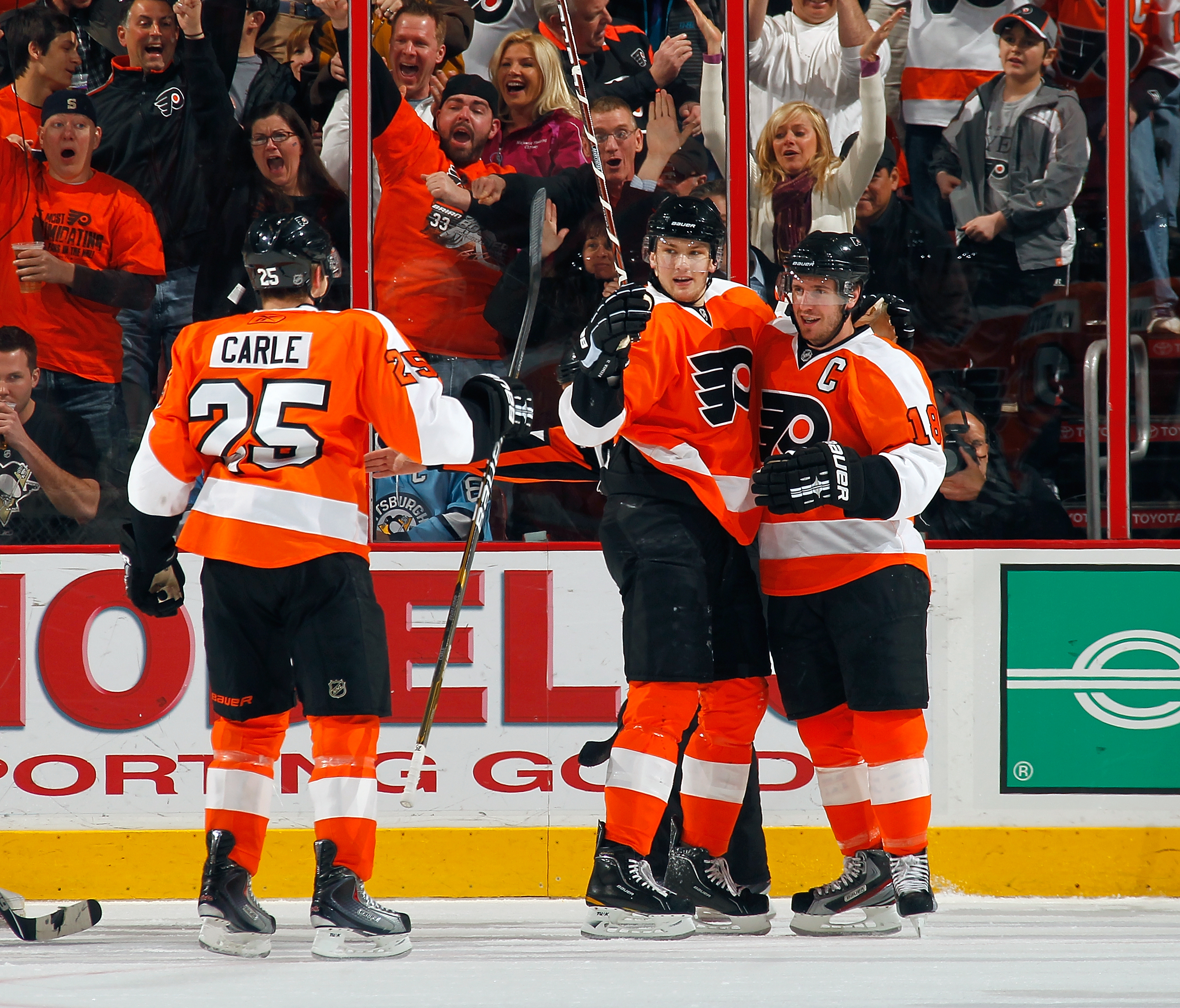 PHILADELPHIA - MARCH 24:  Mike Richards #18 and James van Riemsdyk #21 of the Philadelphia Flyers celebrate Richards' first period goal against the Pittsburgh Penguins on March 24, 2011 at the Wells Fargo Center in Philadelphia, Pennsylvania.  (Photo by L