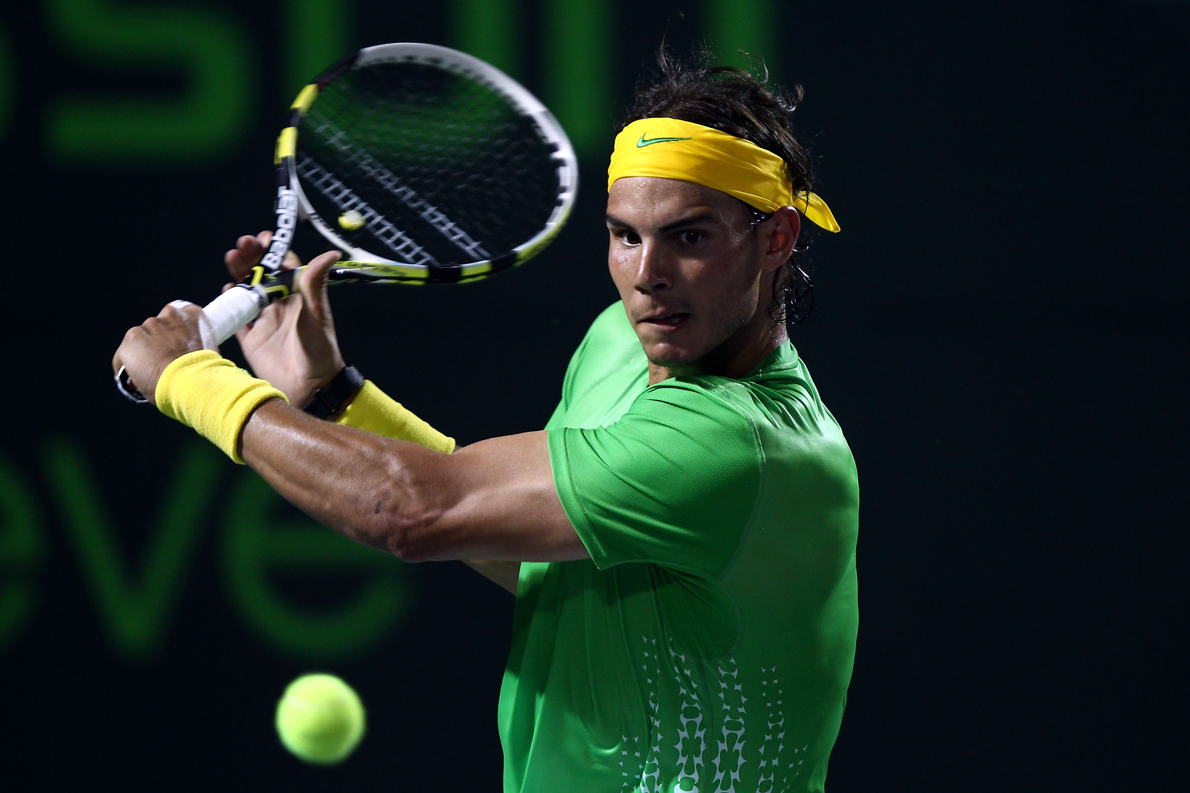 KEY BISCAYNE, FL - MARCH 26:  Rafael Nadal of Spain hits a return shot against Kei Nishikori of Japan during the Sony Ericsson Open at Crandon Park Tennis Center on March 26, 2011 in Key Biscayne, Florida.  (Photo by Clive Brunskill/Getty Images)