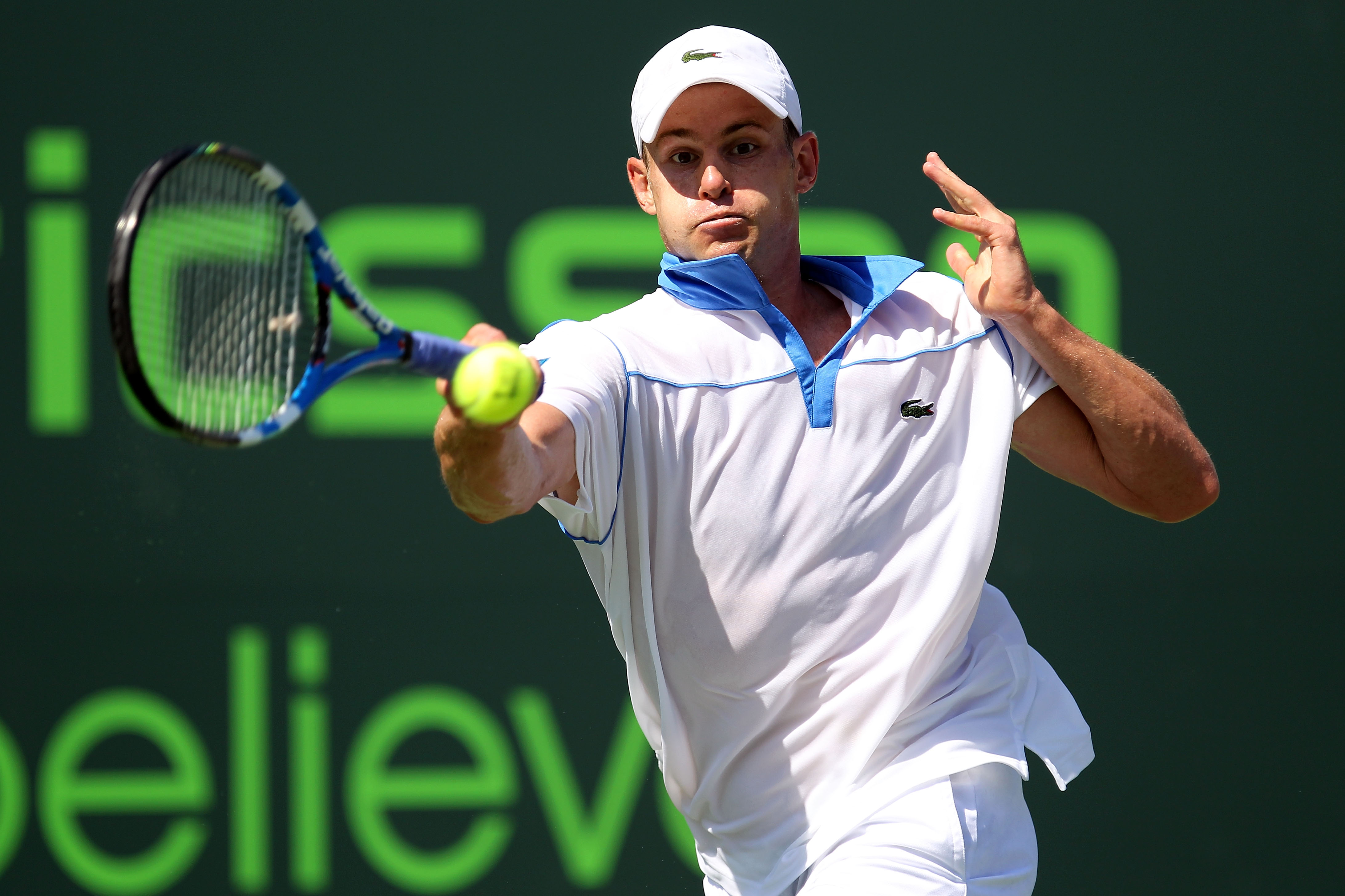 KEY BISCAYNE, FL - MARCH 26:  Andy Roddick hits a forehand return against Pablo Cuevas of Uruguay during the Sony Ericsson Open at Crandon Park Tennis Center on March 26, 2011 in Key Biscayne, Florida.  (Photo by Al Bello/Getty Images)