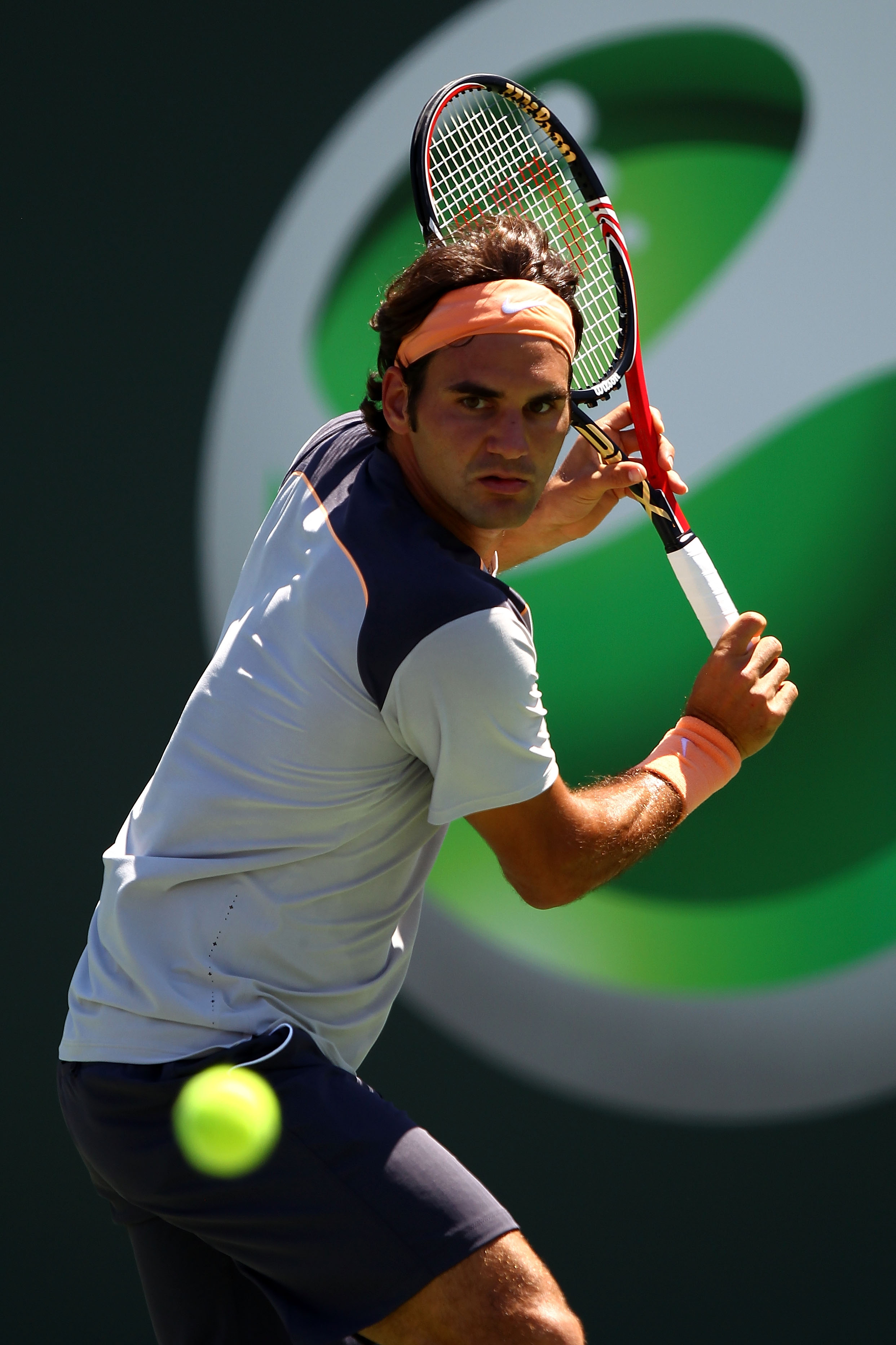 KEY BISCAYNE, FL - MARCH 26:  Roger Federer of Switzerland returns against Radek Stepanek of Czech Republic during the Sony Ericsson Open at Crandon Park Tennis Center on March 26, 2011 in Key Biscayne, Florida.  (Photo by Clive Brunskill/Getty Images)