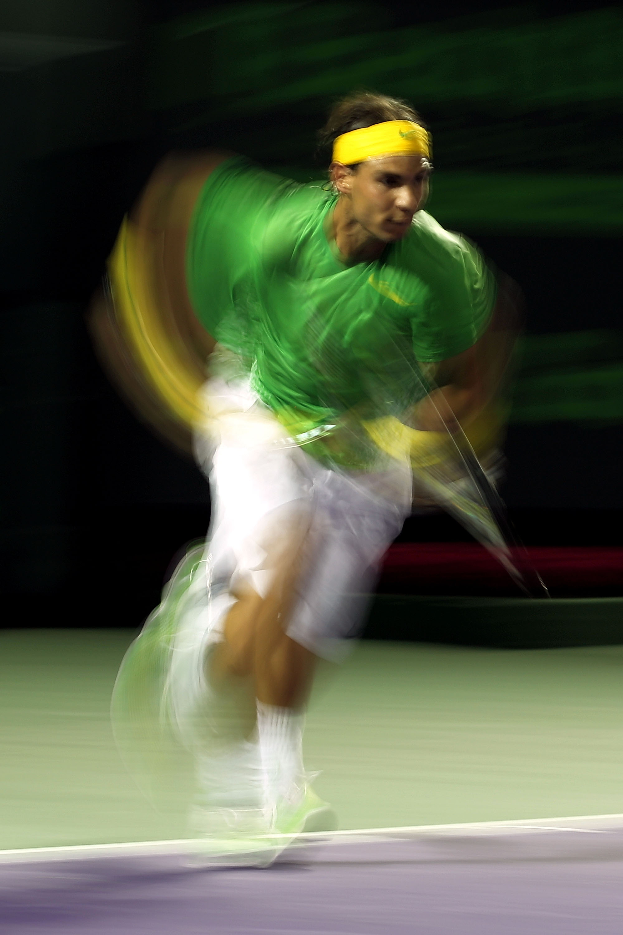 KEY BISCAYNE, FL - MARCH 26:  Rafael Nadal of Spain runs towards the net against Kei Nishikori of Japan during the Sony Ericsson Open at Crandon Park Tennis Center on March 26, 2011 in Key Biscayne, Florida.  (Photo by Al Bello/Getty Images)