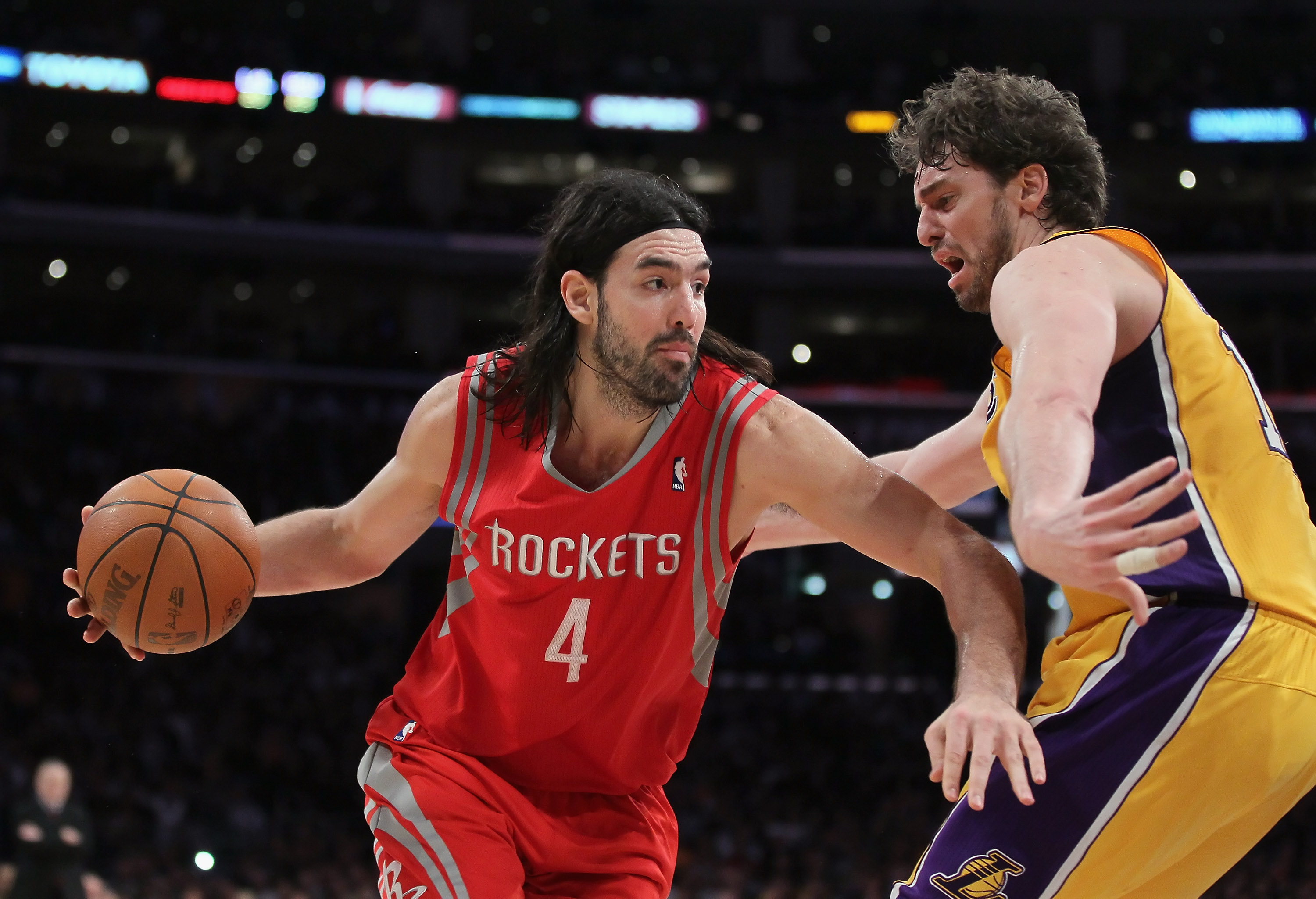 LOS ANGELES, CA - FEBRUARY 01:  Luis Scola #4 of the Houston Rockets is defended by Pau Gasol #16 of the Los Angeles Lakers in the second half at Staples Center on February 1, 2011 in Los Angeles, California. The Lakers defeated the Rockets 114-106. NOTE