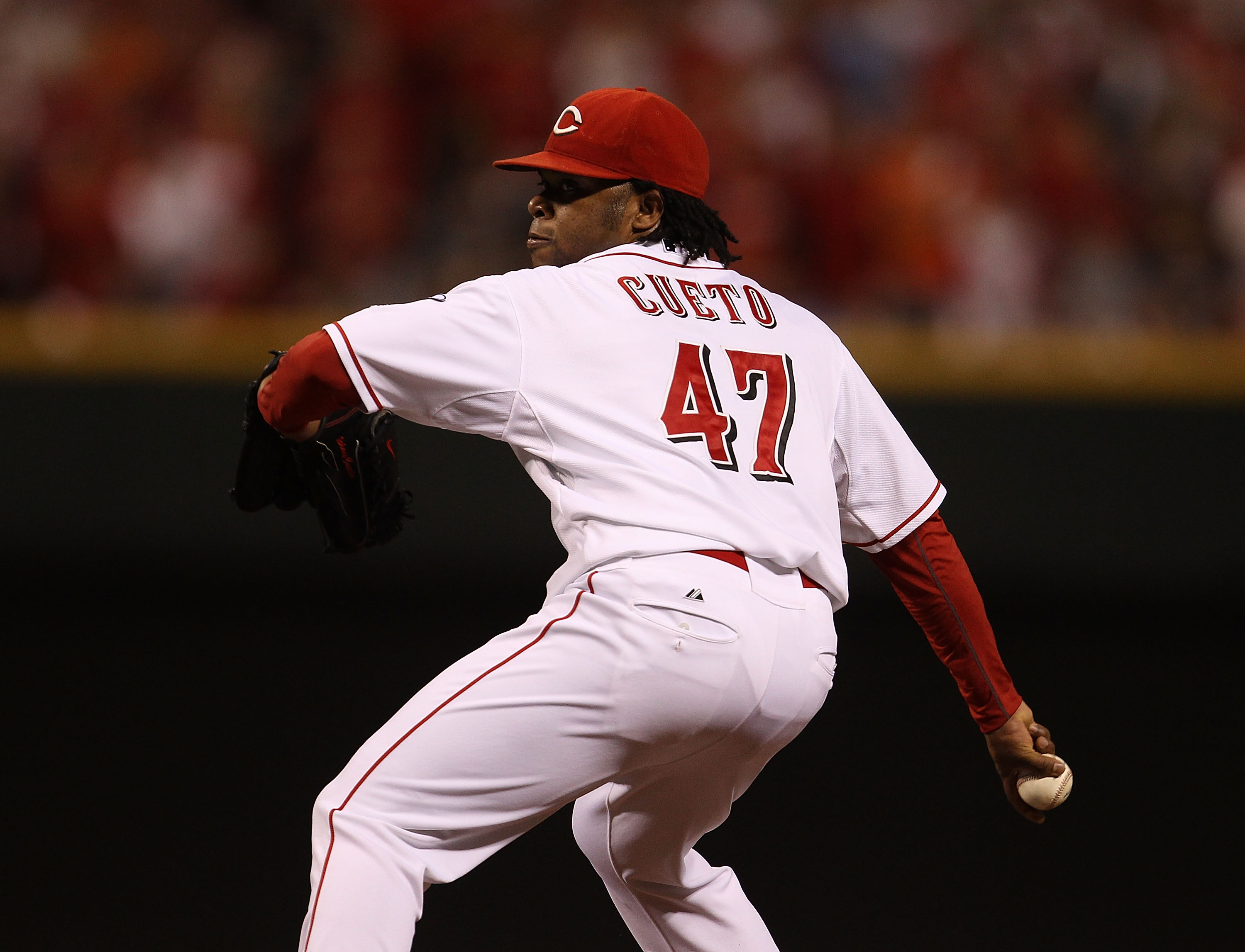 CINCINNATI - OCTOBER 10: Starting pitcher Johnny Cueto #47 of the Cincinnati Reds delivers the ball against the Philadelphia Phillies during game 3 of the NLDS at Great American Ball Park on October 10, 2010 in Cincinnati, Ohio. The Phillies defeated the