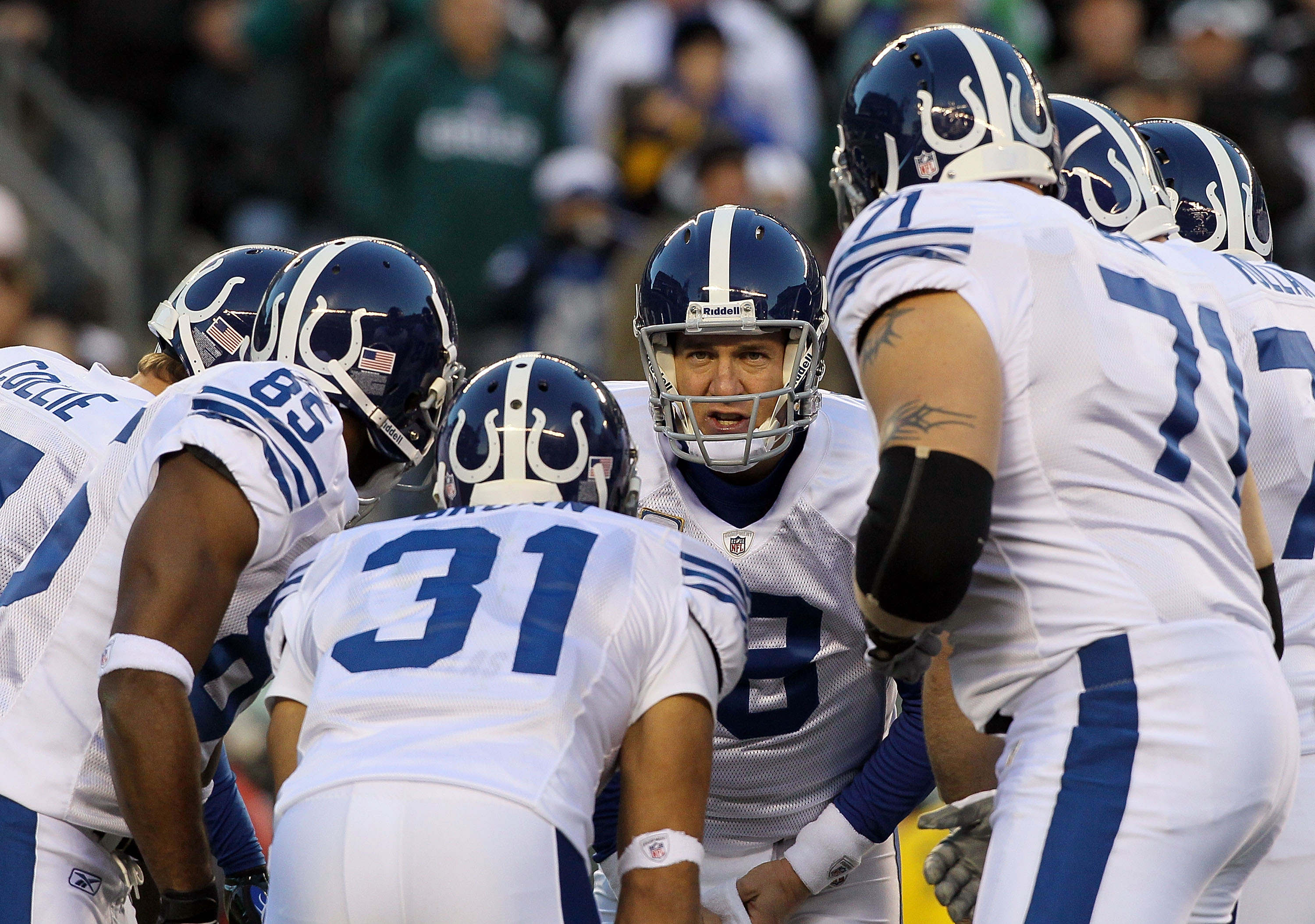 PHILADELPHIA - NOVEMBER 07:  Peyton Manning #18 of the Indianapolis Colts huddles with his team against the Philadelphia Eagles on November 7, 2010 at Lincoln Financial Field in Philadelphia, Pennsylvania.  (Photo by Jim McIsaac/Getty Images)