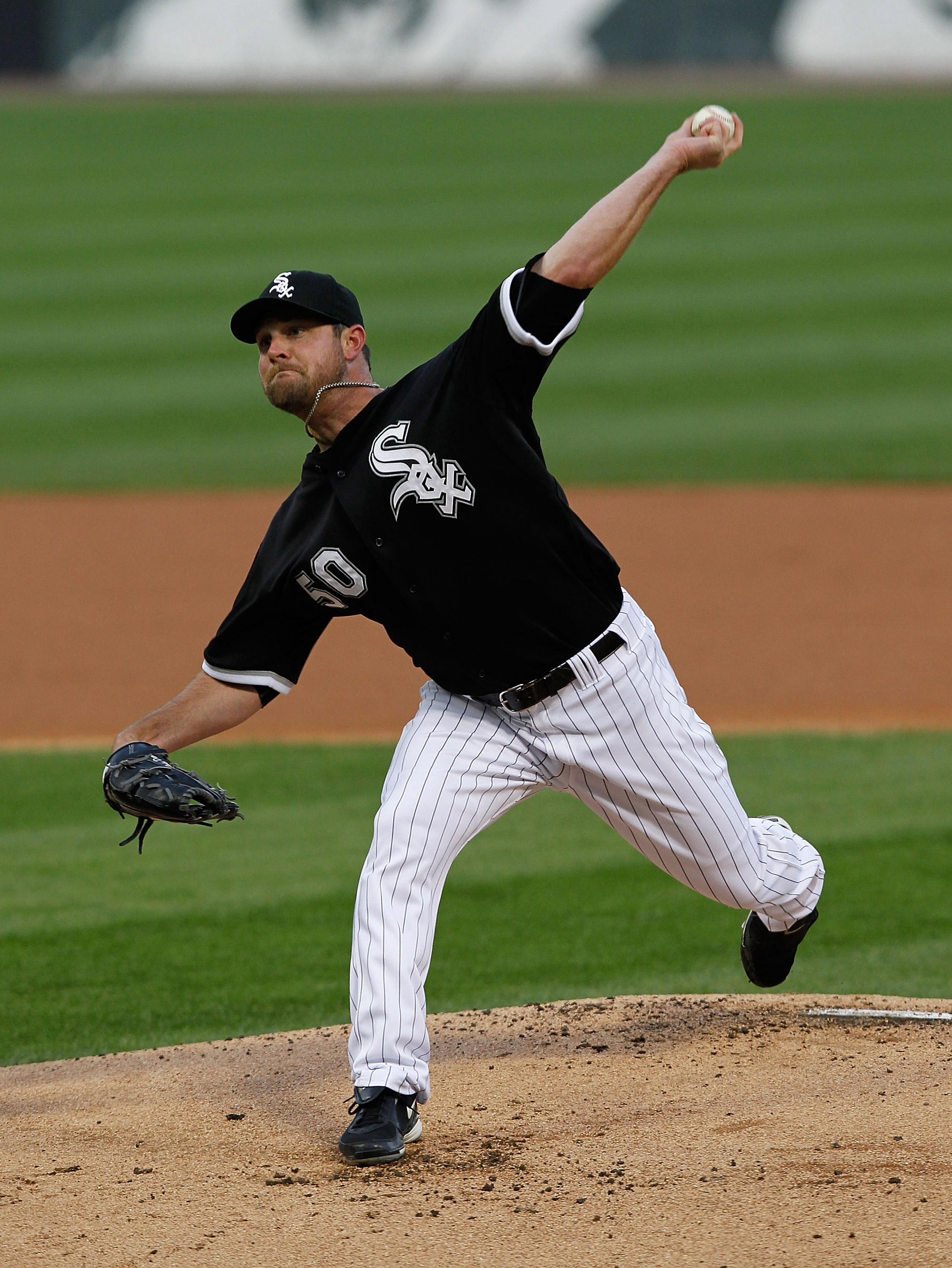 CHICAGO - MAY 06: Starting pitcher John Danks #50 of the Chicago White Sox delivers the ball against the Toronto Blue Jays at U.S. Cellular Field on May 6, 2010 in Chicago, Illinois. (Photo by Jonathan Daniel/Getty Images)