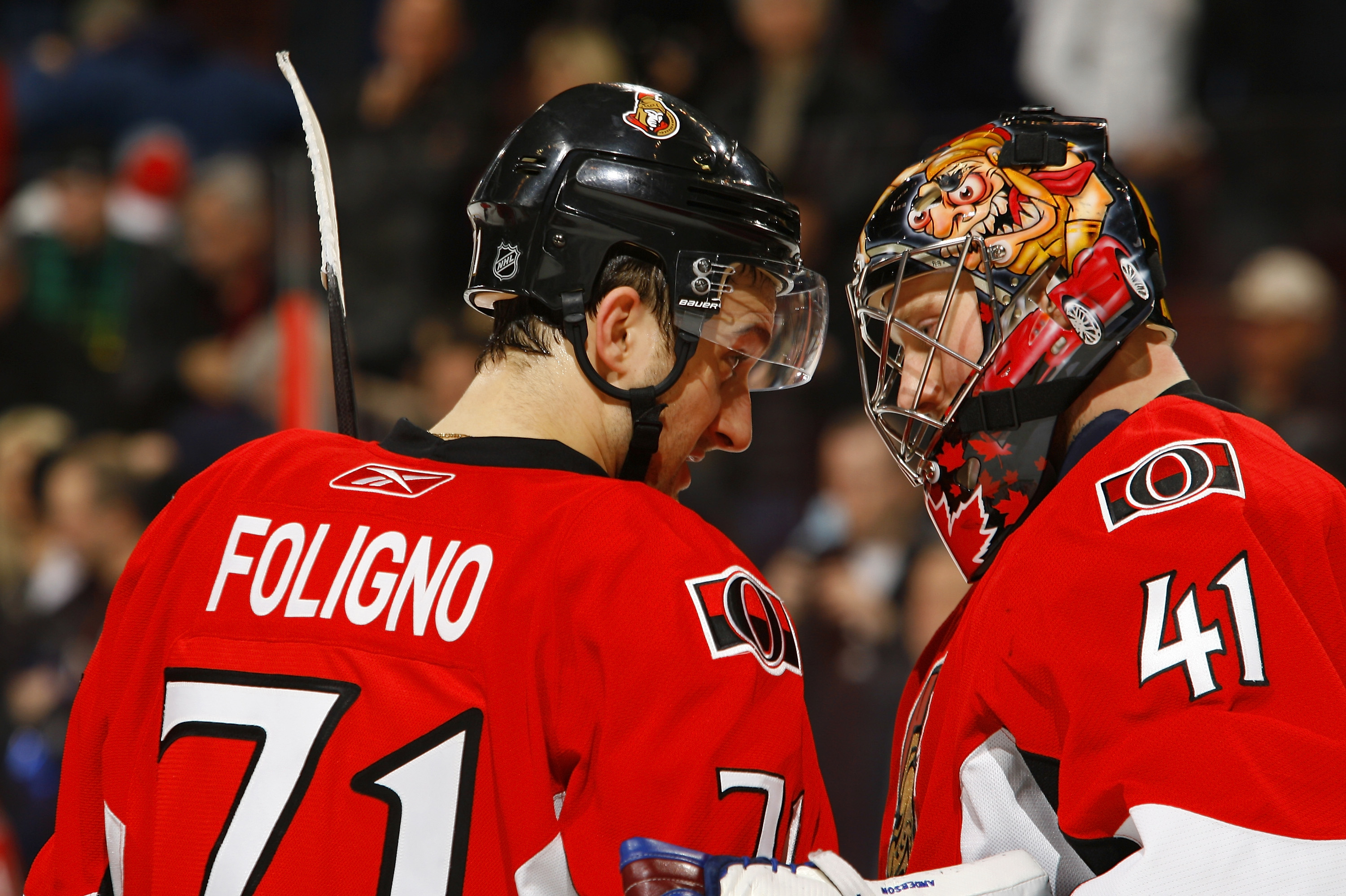 OTTAWA, CANADA - MARCH 25:  Nick Foligno #71 of the Ottawa Senators congratulates teammate Craig Anderson #41 on his shutout victory over the Washington Capitals in a game at Scotiabank Place on March 25, 2011 in Ottawa, Canada.  (Photo by Phillip MacCall