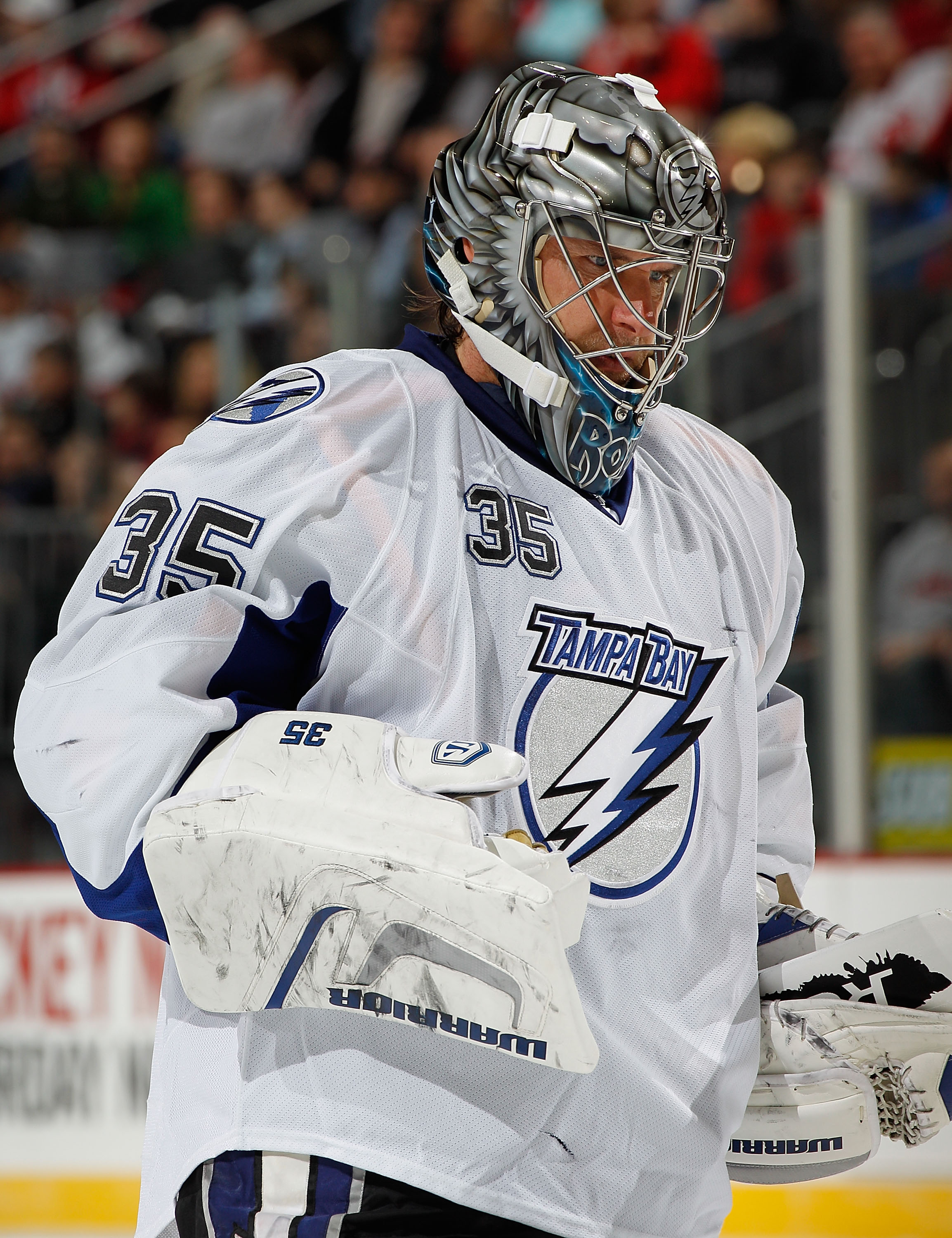NEWARK, NJ - MARCH 02:  Goalie Dwayne Roloson #35 of the Tampa Bay Lightning relaxes during a timeout in an NHL hockey game against the New Jersey Devils at the Prudential Center on March 2, 2011 in Newark, New Jersey.  (Photo by Paul Bereswill/Getty Imag