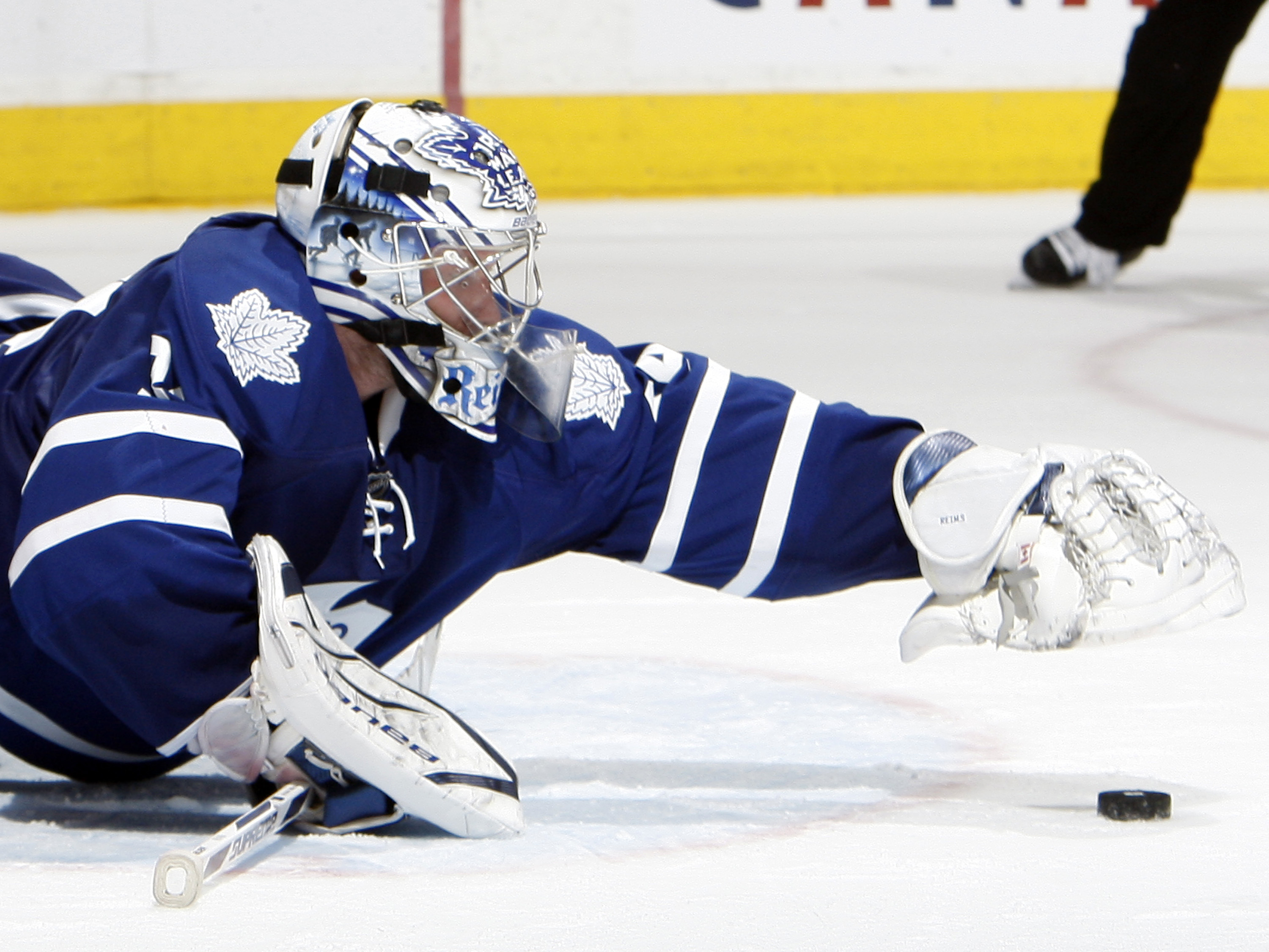 TORONTO, CANADA - FEBRUARY 26: James Reimer #34 of the Toronto Maple Leafs jumps on a rebound against the Pittsburgh Penguins during game action at the Air Canada Centre February 26, 2011 in Toronto, Ontario, Canada. (Photo by Abelimages/Getty Images)