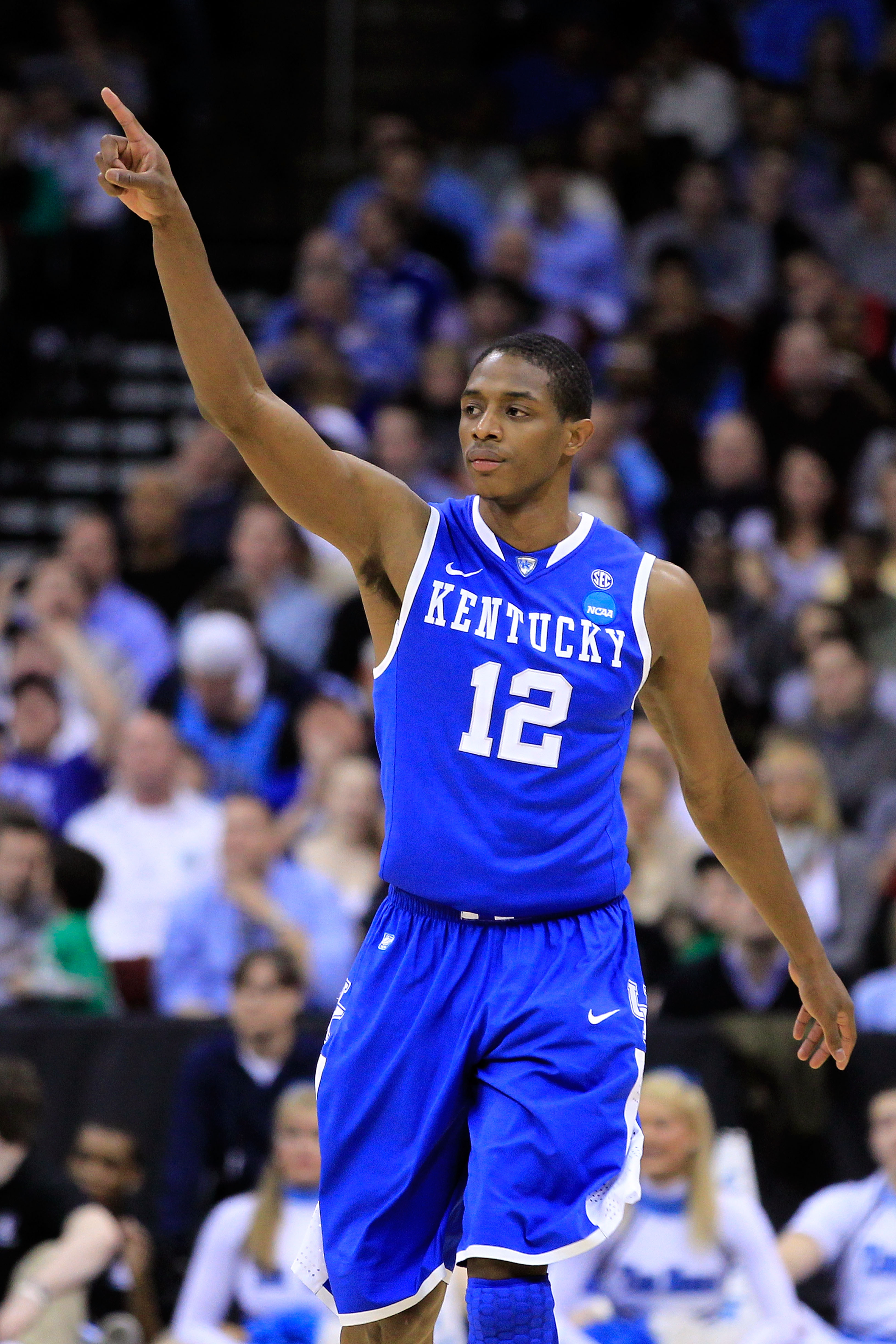 NEWARK, NJ - MARCH 27:  Brandon Knight #12 of the Kentucky Wildcats celebrates after a play against the North Carolina Tar Heels during the second half of the east regional final of the 2011 NCAA men's basketball tournament at Prudential Center on March 2