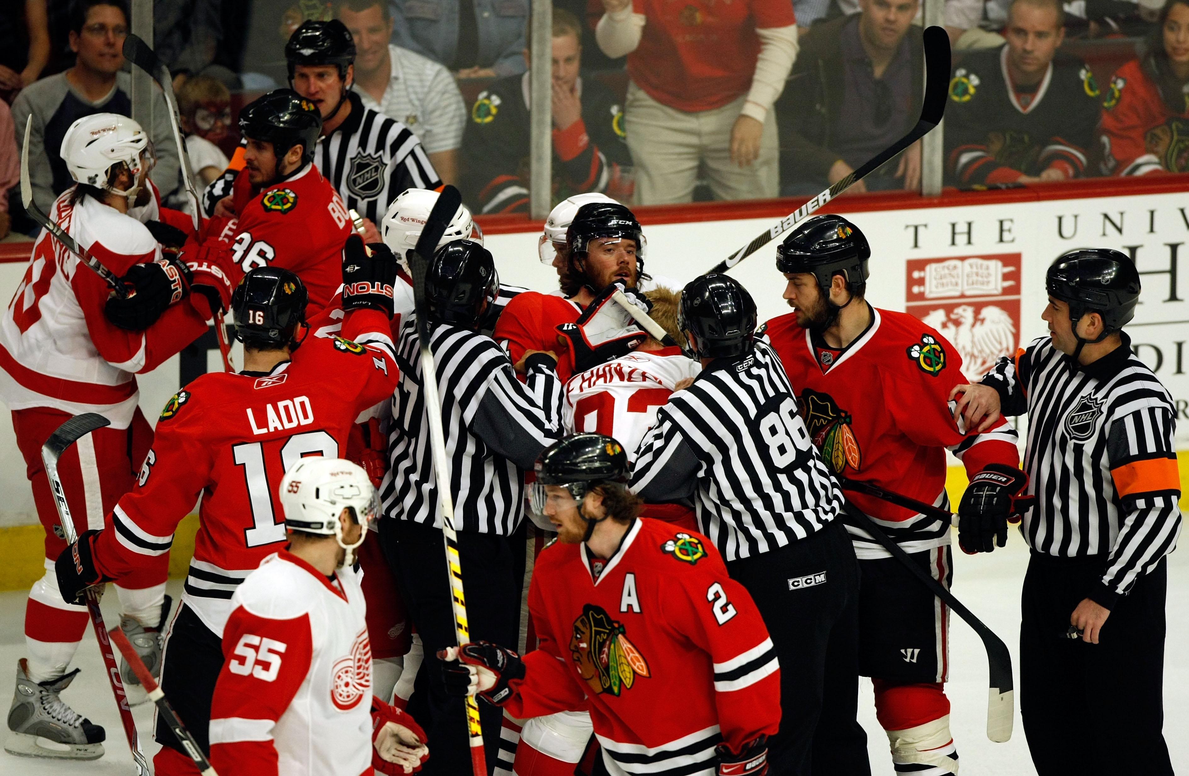 CHICAGO - MAY 24:  Officals attempt to seperate players as Martin Havlat #24 (C) of the Chicago Blackhawks fights with Johan Franzen #93 of the Detroit Red Wings during Game Four of the Western Conference Championship Round of the 2009 Stanley Cup Playoff