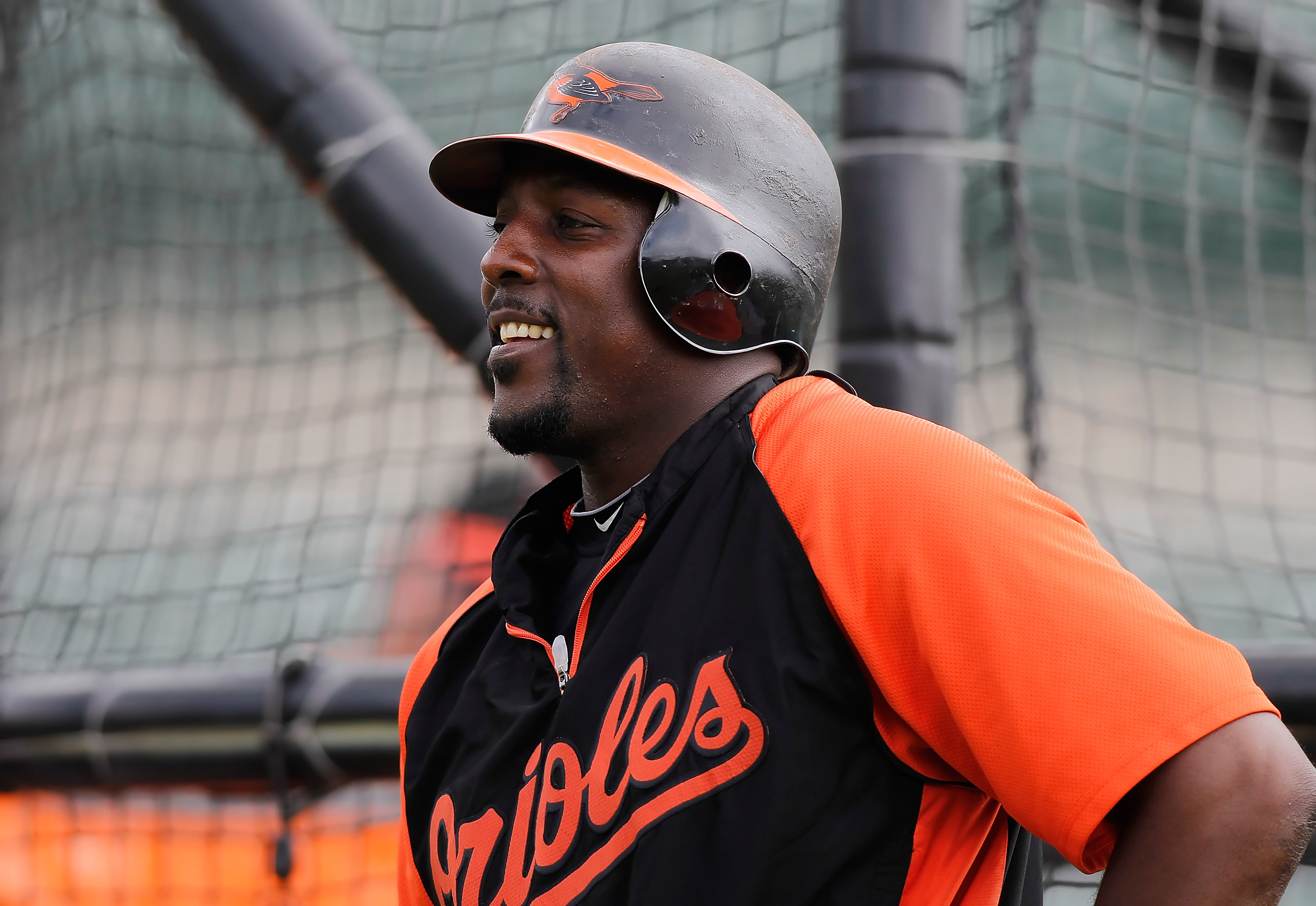 SARASOTA, FL - MARCH 05:  Designated hitter Vladimir Guerrero #27 of the Baltimore Orioles smiles during batting practice just before the start of the Grapefruit League Spring Training Game against the Boston Red Sox at Ed Smith Stadium on March 5, 2011 i